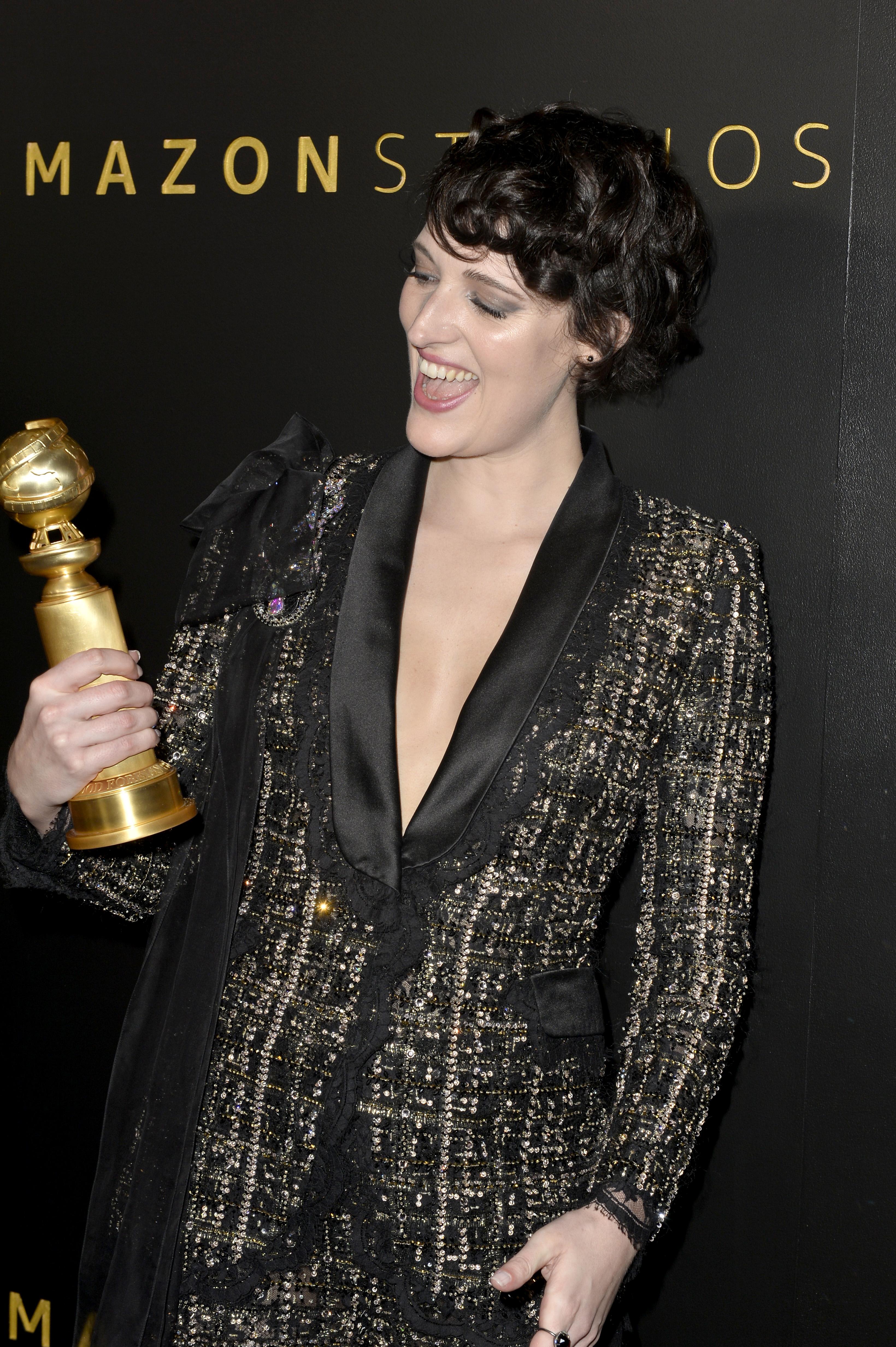 Fleabag star Phoebe Waller-Bridge holds her brand new Golden Globe trophy.