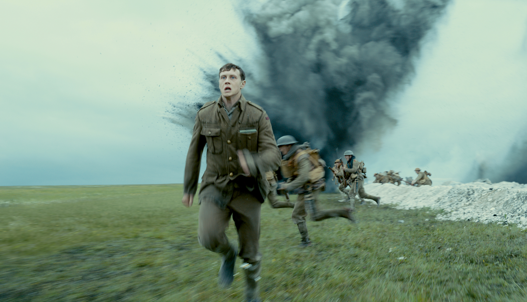 a man runs away from a bomb hitting the trenches