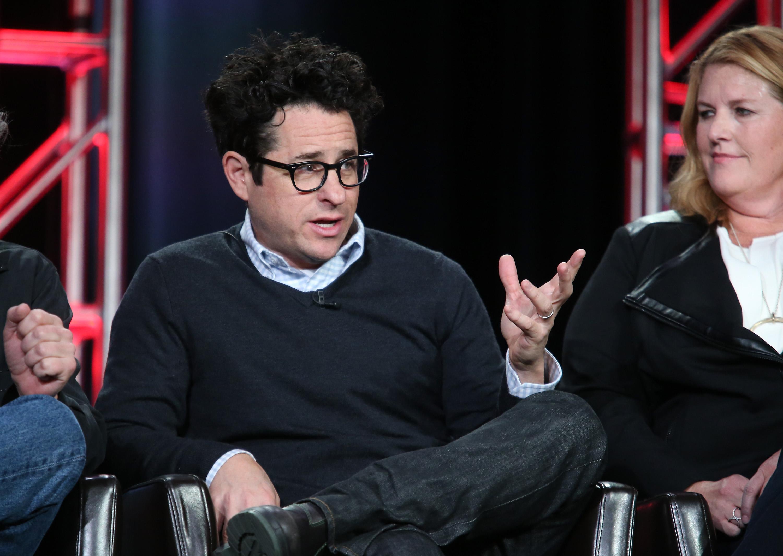 Film director J.J. Abrams speaking onstage.