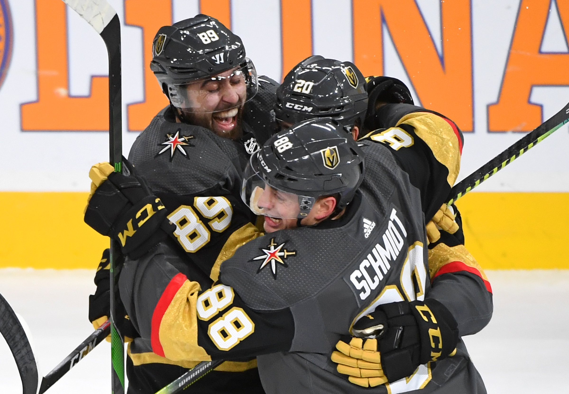 Jan 4, 2020; Las Vegas, Nevada, USA; Vegas Golden Knights players celebrate after Vegas Golden Knights center Chandler Stephenson (20) scored in overtime to give the Golden Knights a 5-4 victory over the St. Louis Blues at T-Mobile Arena.