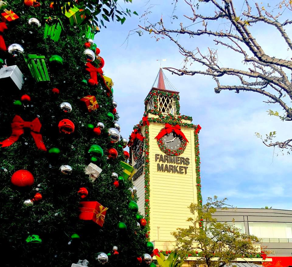 A Christmas tree and clock tower for a farmers market.