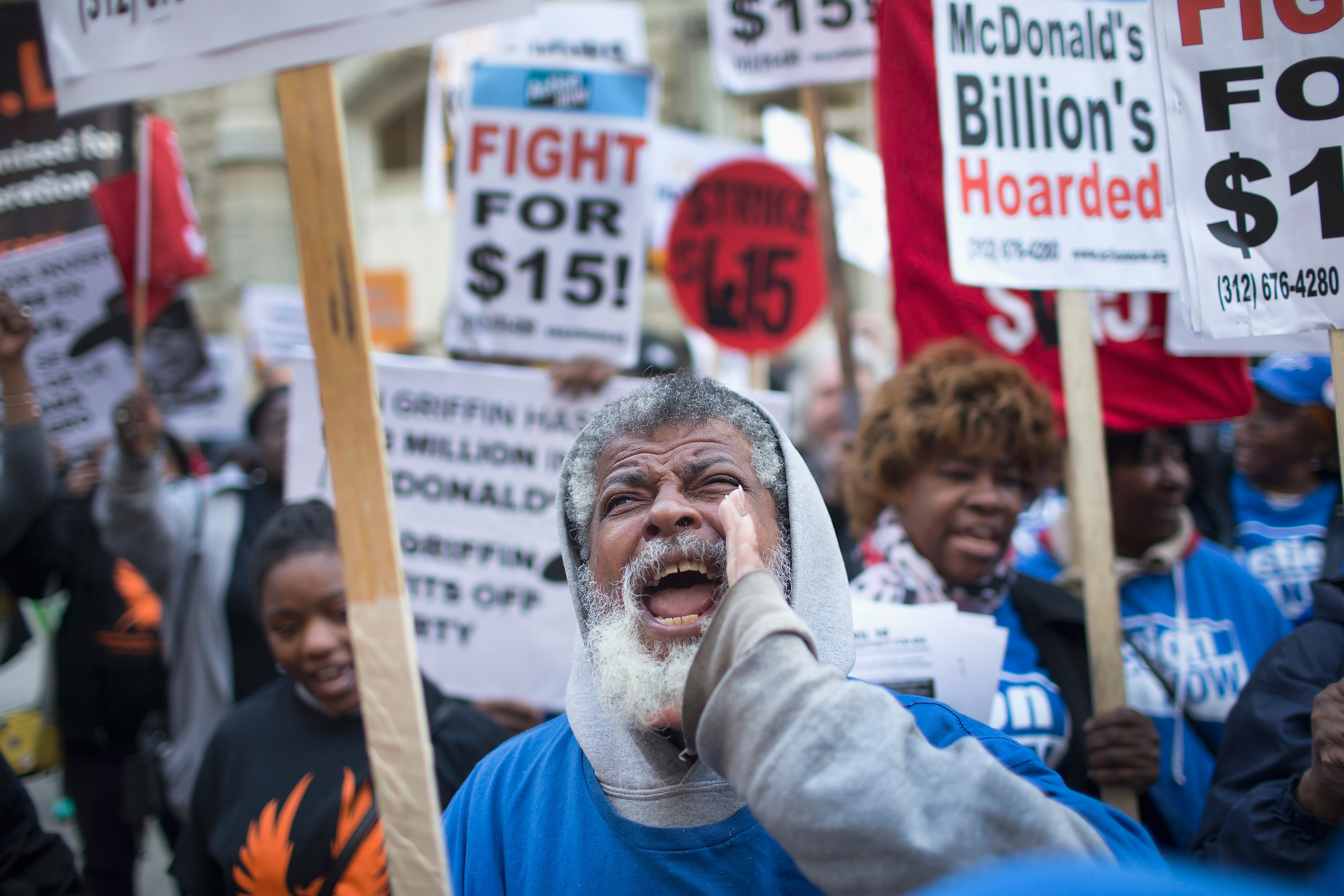 Demonstrators demanding an increase in the minimum wage to $15 an hour prepare to march on April 14, 2016 in Chicago.