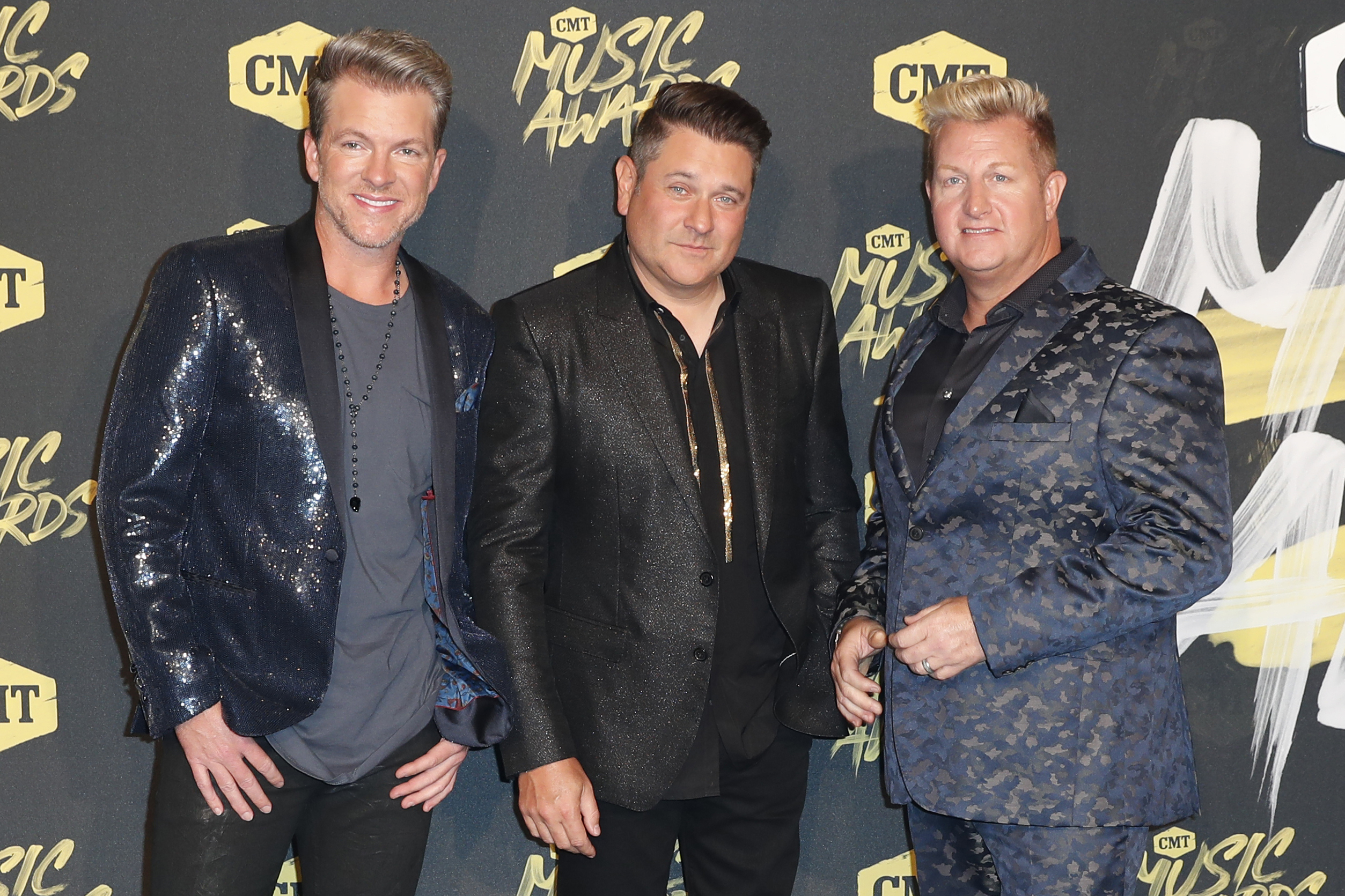 Joe Don Rooney (from left), Jay DeMarcus and Gary LeVox, of Rascal Flatts arrive at the 2018 CMT Music Awards in Nashville, Tennessee.