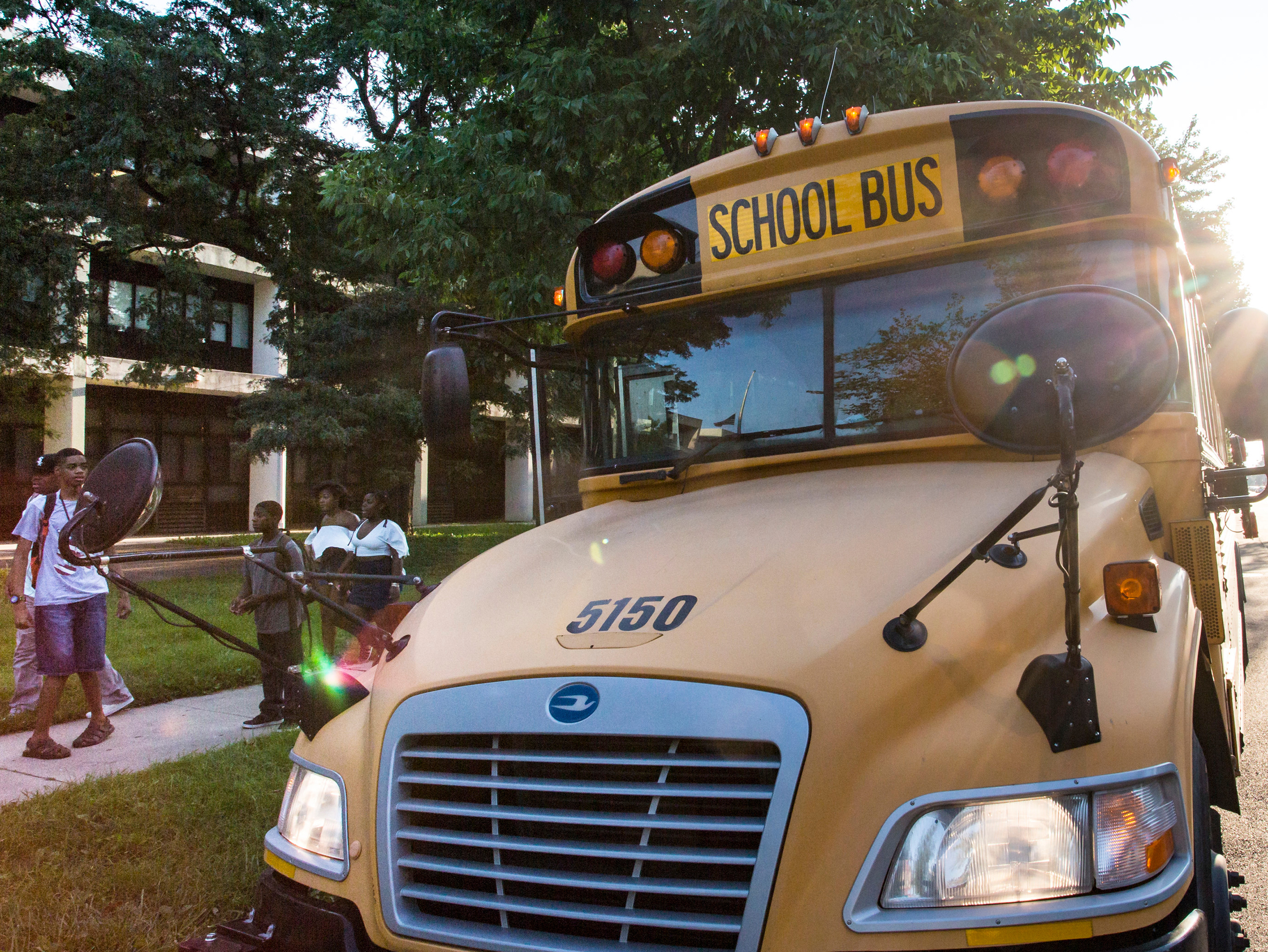 Students getting off a school bus outside Dr. Martin Luther King. Jr. College Prep in September 2016.