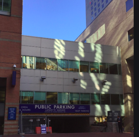 The entry of an urban parking garage.