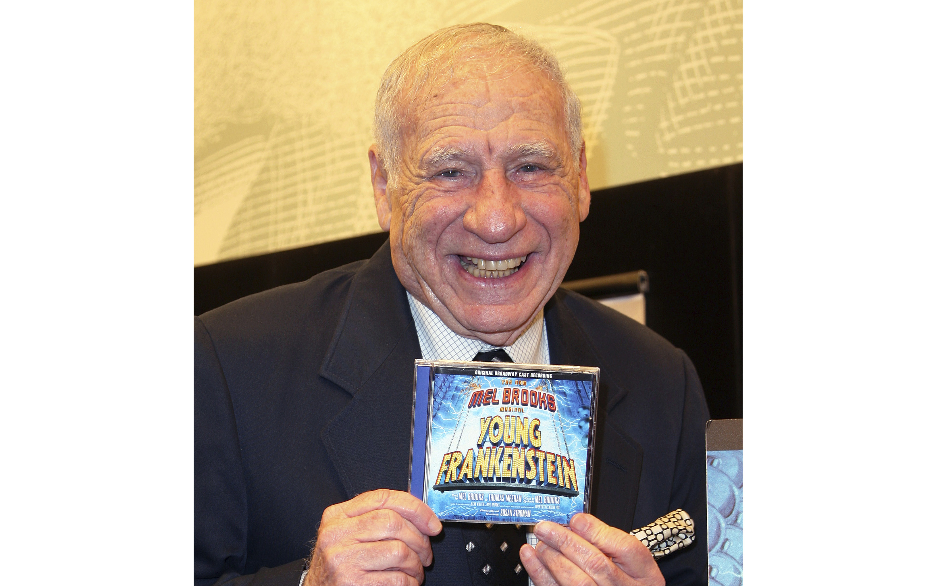 """This 2008 file photo shows Mel Brooks posing with the CD of the Broadway performance sound track of """"Young Frankenstein"""" in New York."""