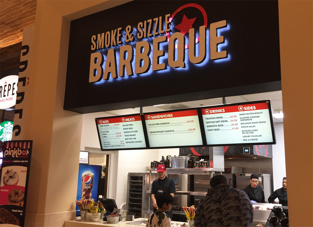 The counter at Smoke & Sizzle Barbecue, now open at the Caesars Palace Forum Food Court.