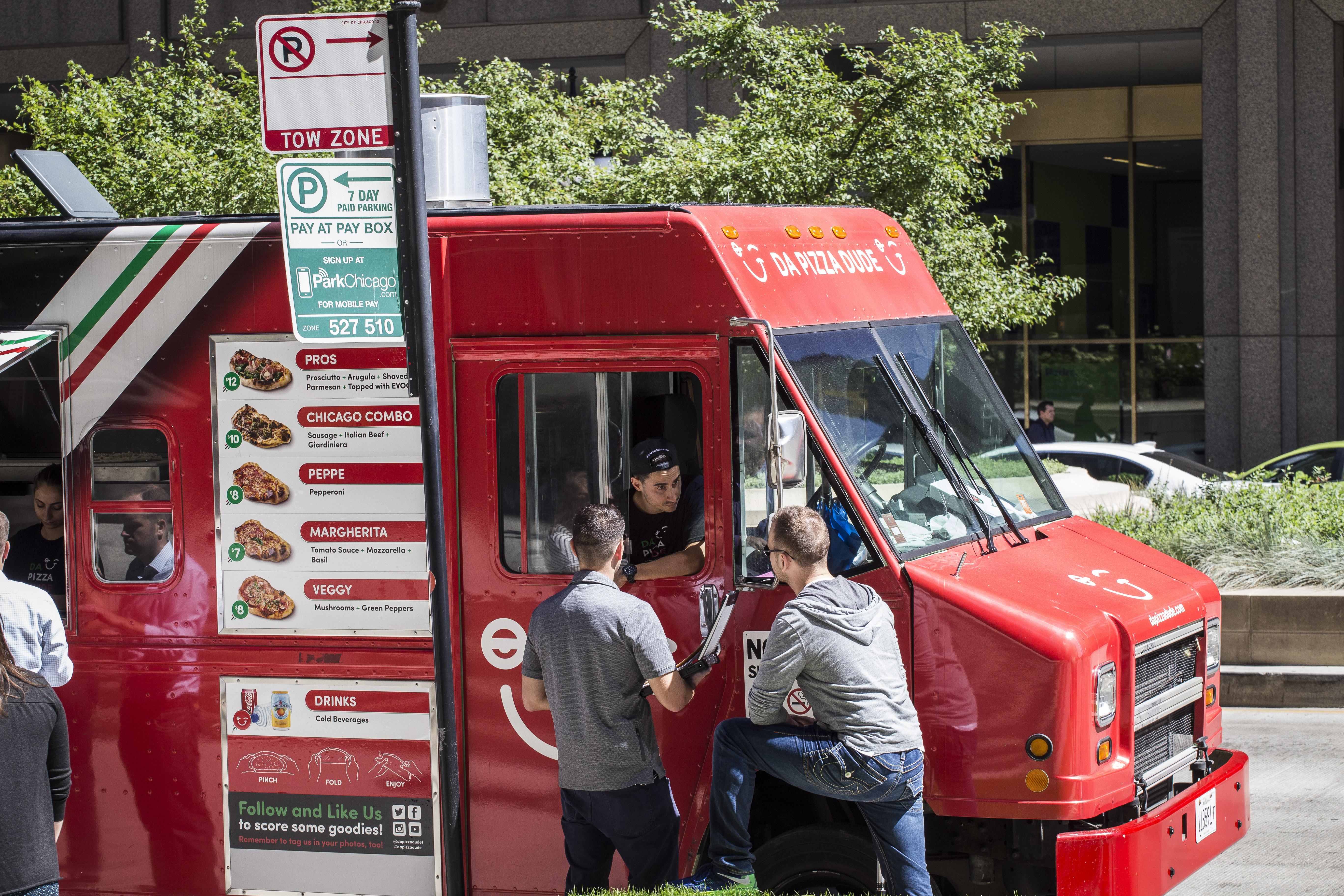 City inspectors check licenses of food trucks on Wacker Drive.