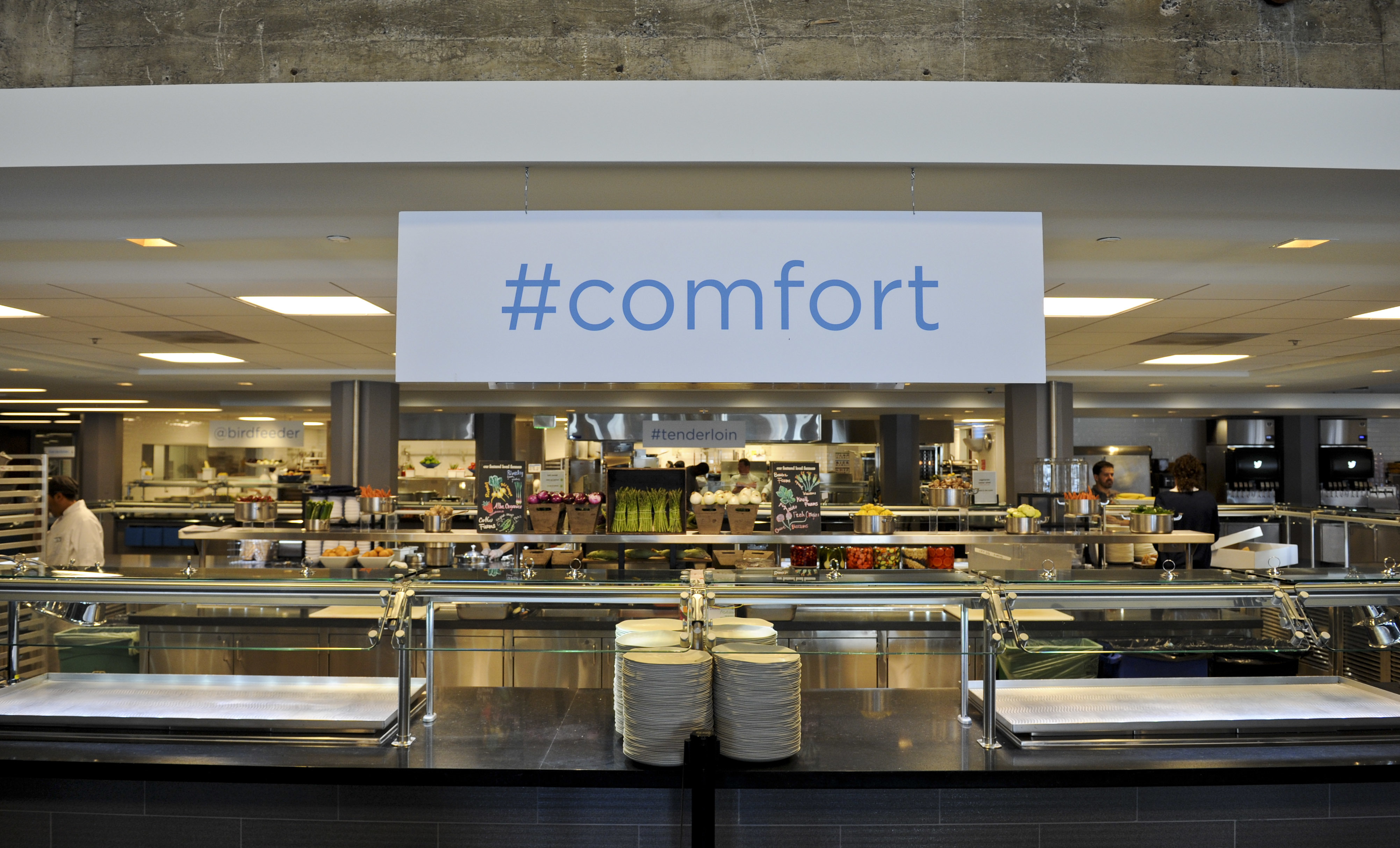 "Inside the Twitter corporate kitchen, which has a sign that says ""#comfort."""