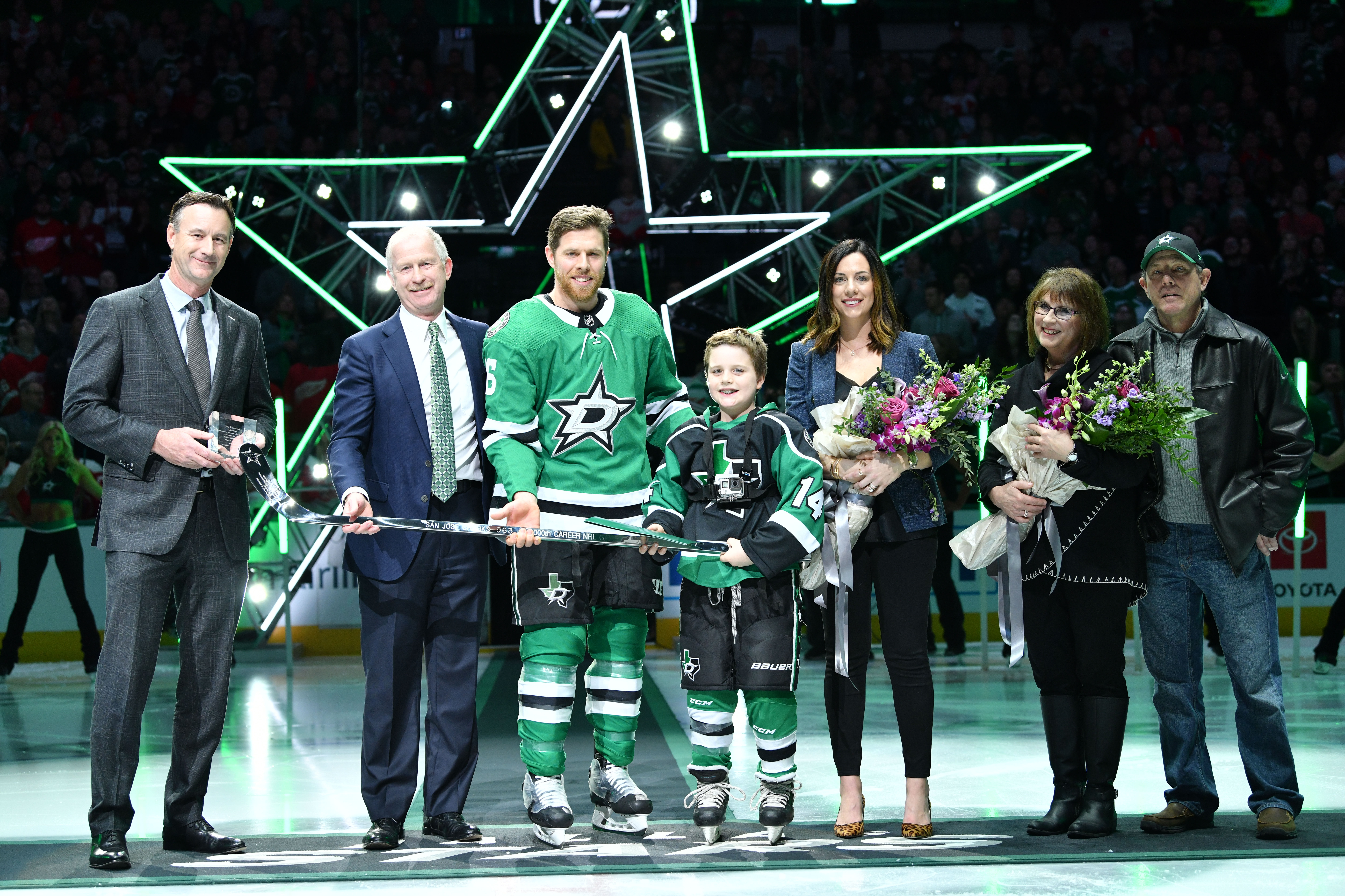 Joe Pavelski #16 of the Dallas Stars is honored during a pre-game ceremony for his recent 1000th NHL game played milestone by Dallas Stars Team President Brad Alberts and General Manager Jim Nill before a game against the Detroit Red Wings at the American Airlines Center on January 3, 2019 in Dallas, Texas.