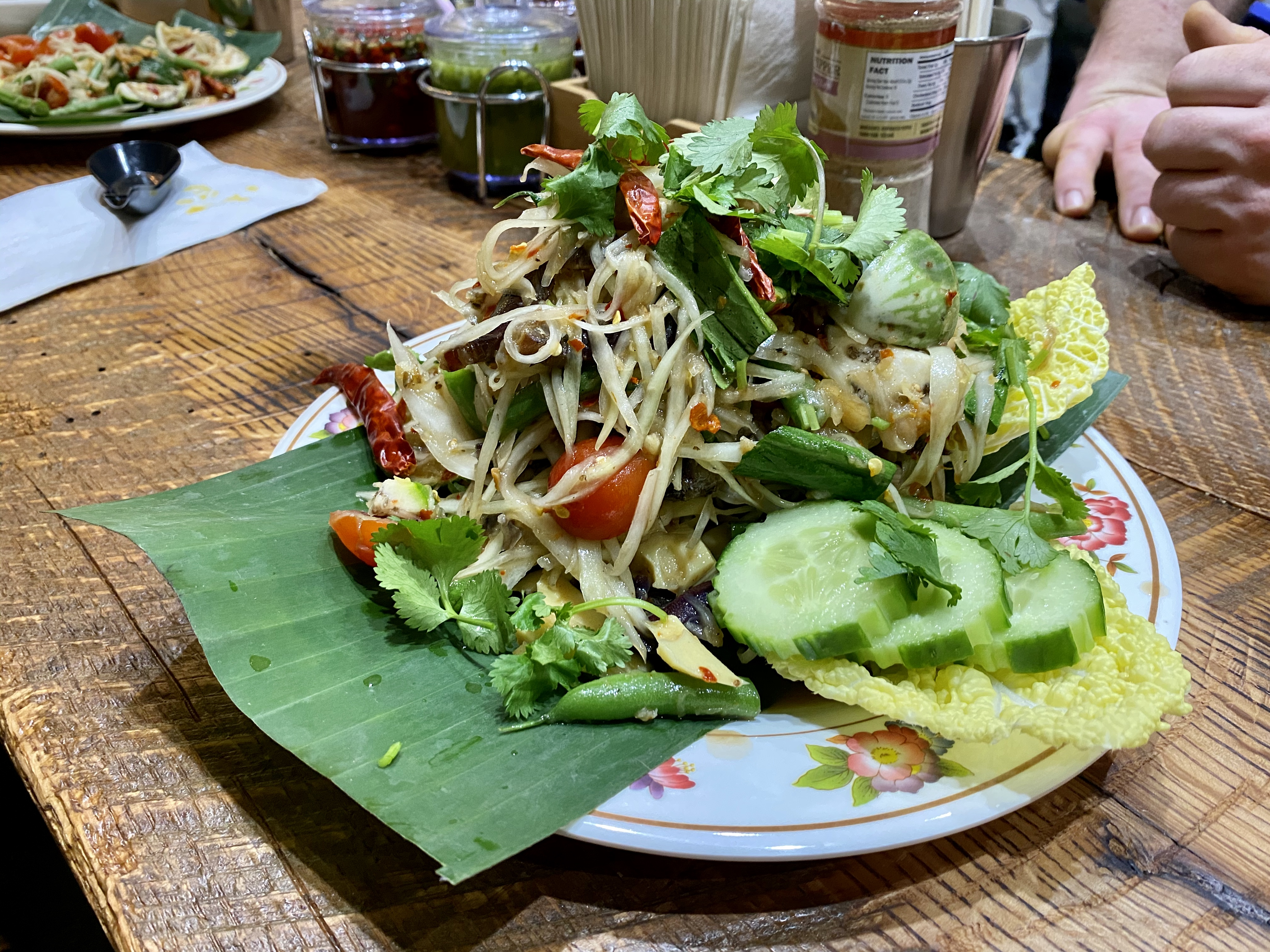 "A heaping ""jungle style"" salad incorporates rice noodles, cucumber, dried shrimp, fermented fish sauce, crab paste, bamboo, dried chiles, long beans, and whelks."