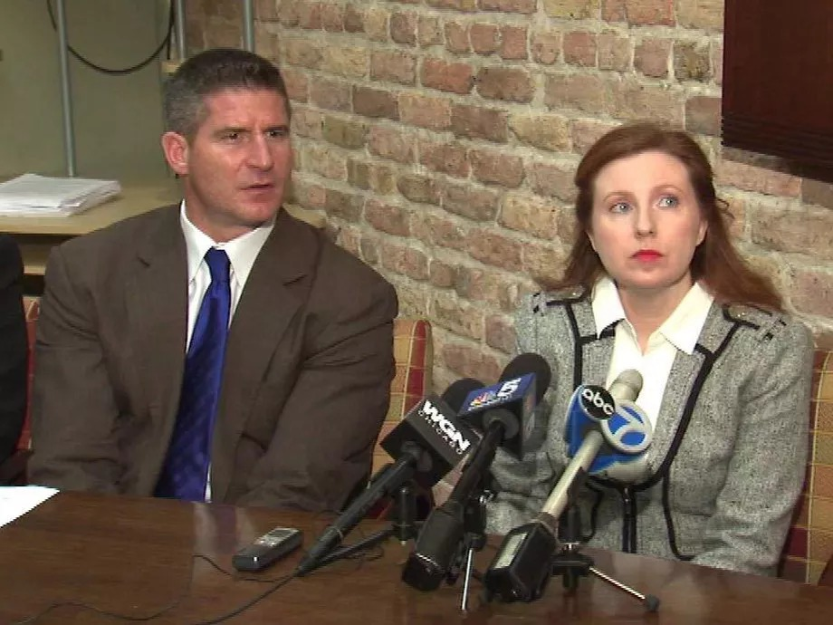 Chicago Police Officer Kelly Hespe and her attorney, Dan Herbert, announcing their lawsuit against the city in 2013.