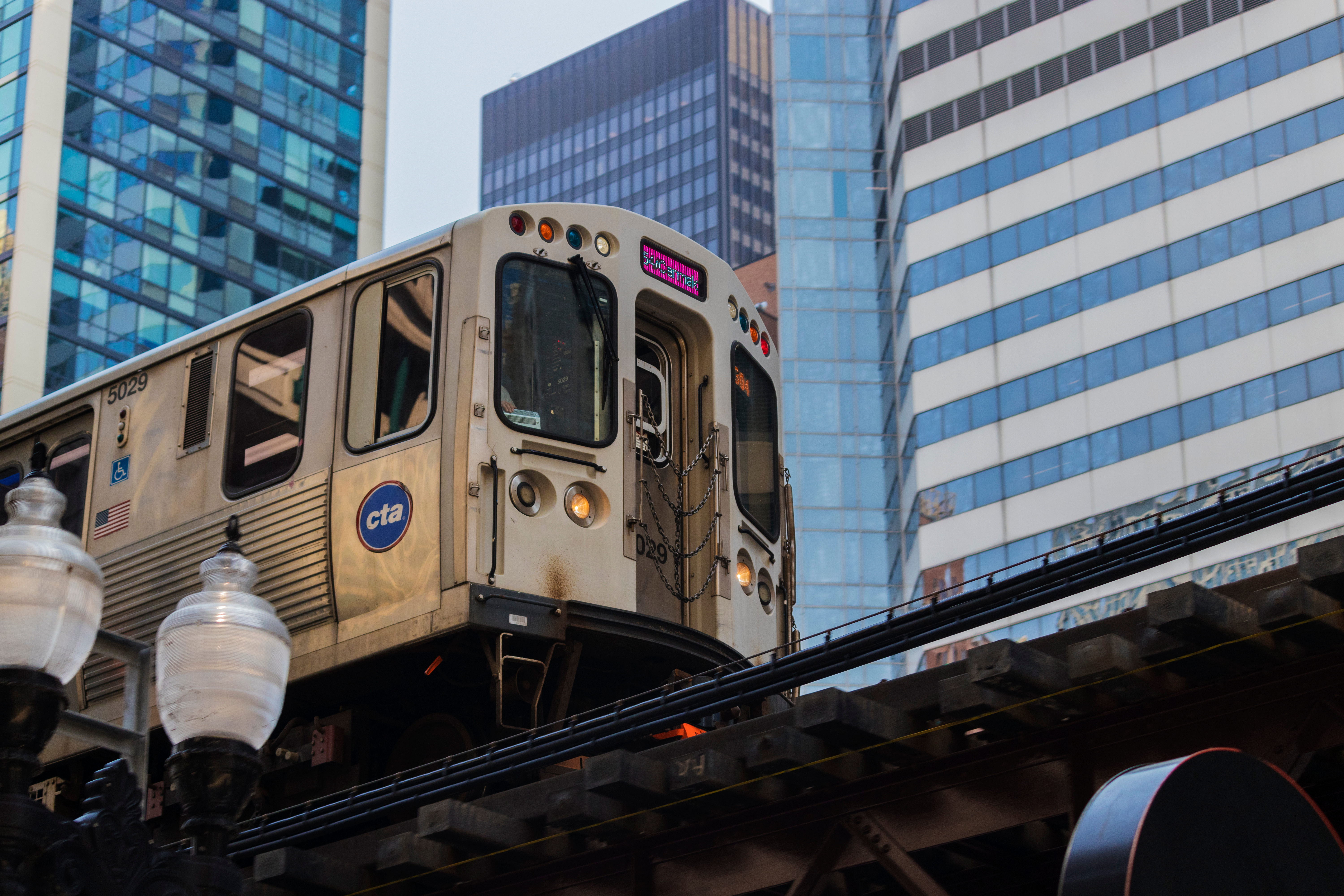 A Chicago CTA train runs through elevated lines in the downtown business district.