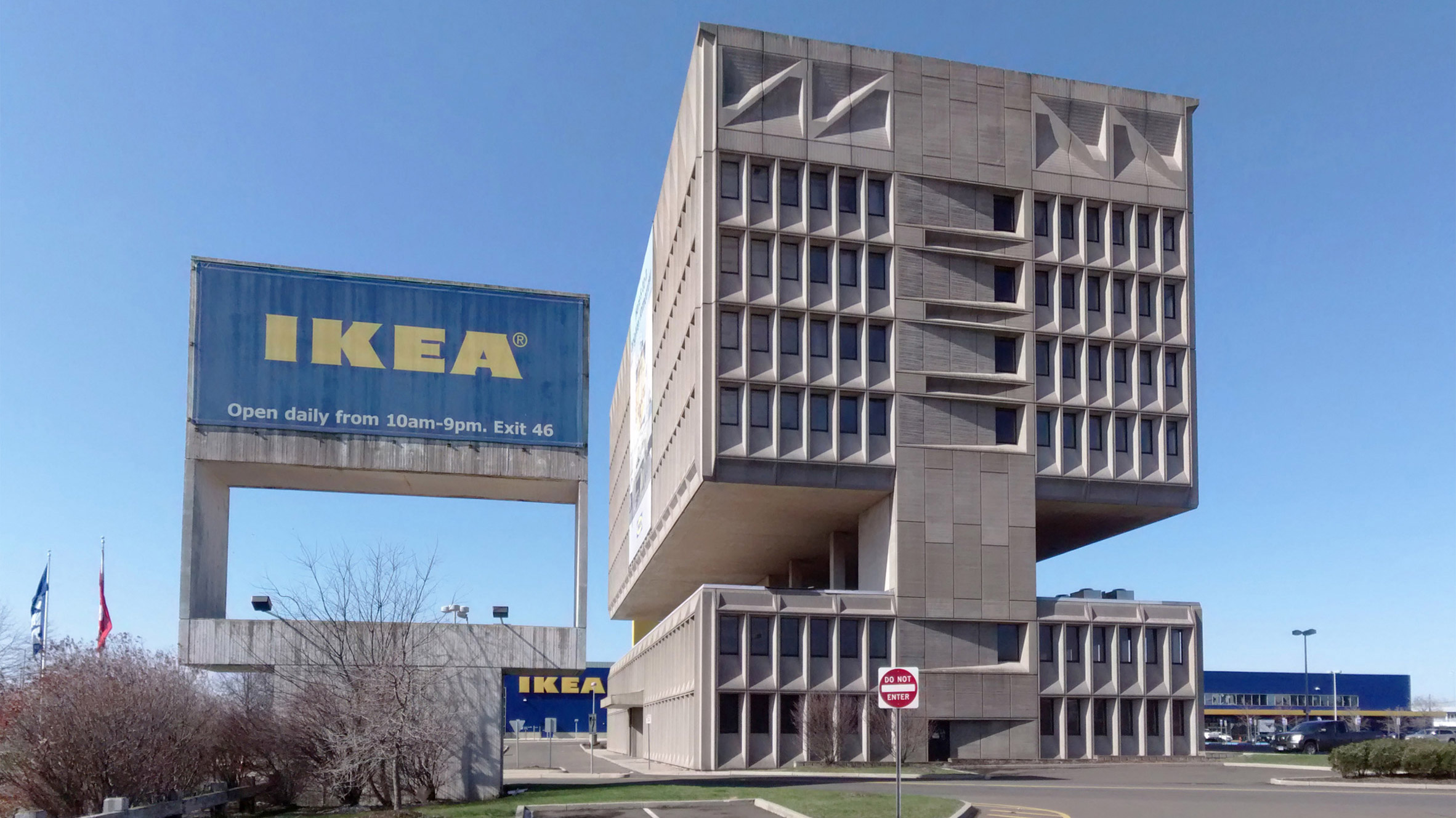 Shot of brutalist building next to Ikea sign.