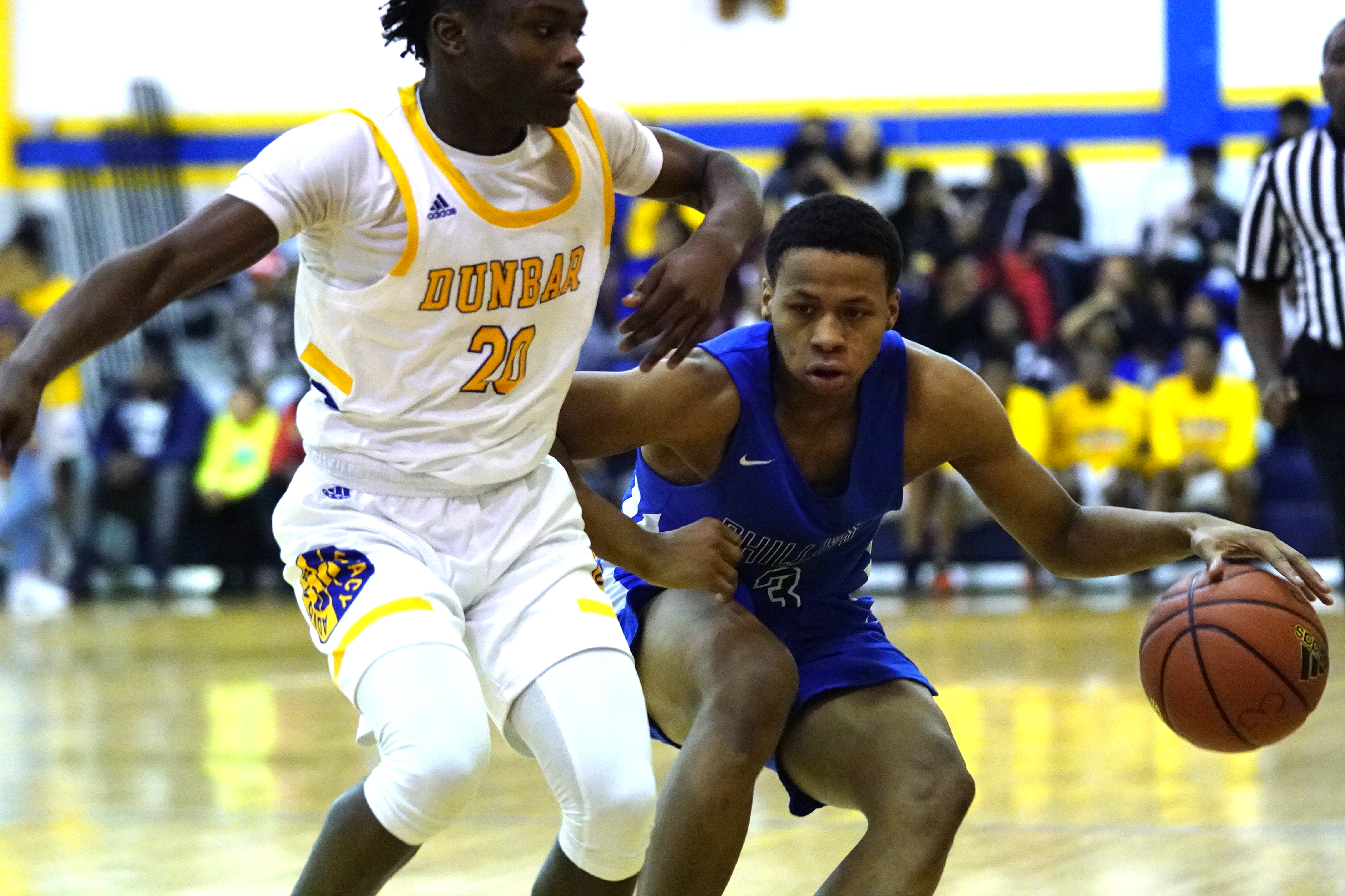 Phillips senior Lewis Paty (3) tries to make a move past Dunbar's Edward Butler (20).