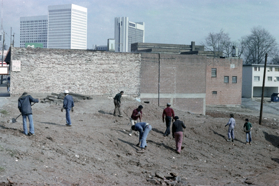A group of people cleaning a dirty area in Midtown Atlanta in 1970s.