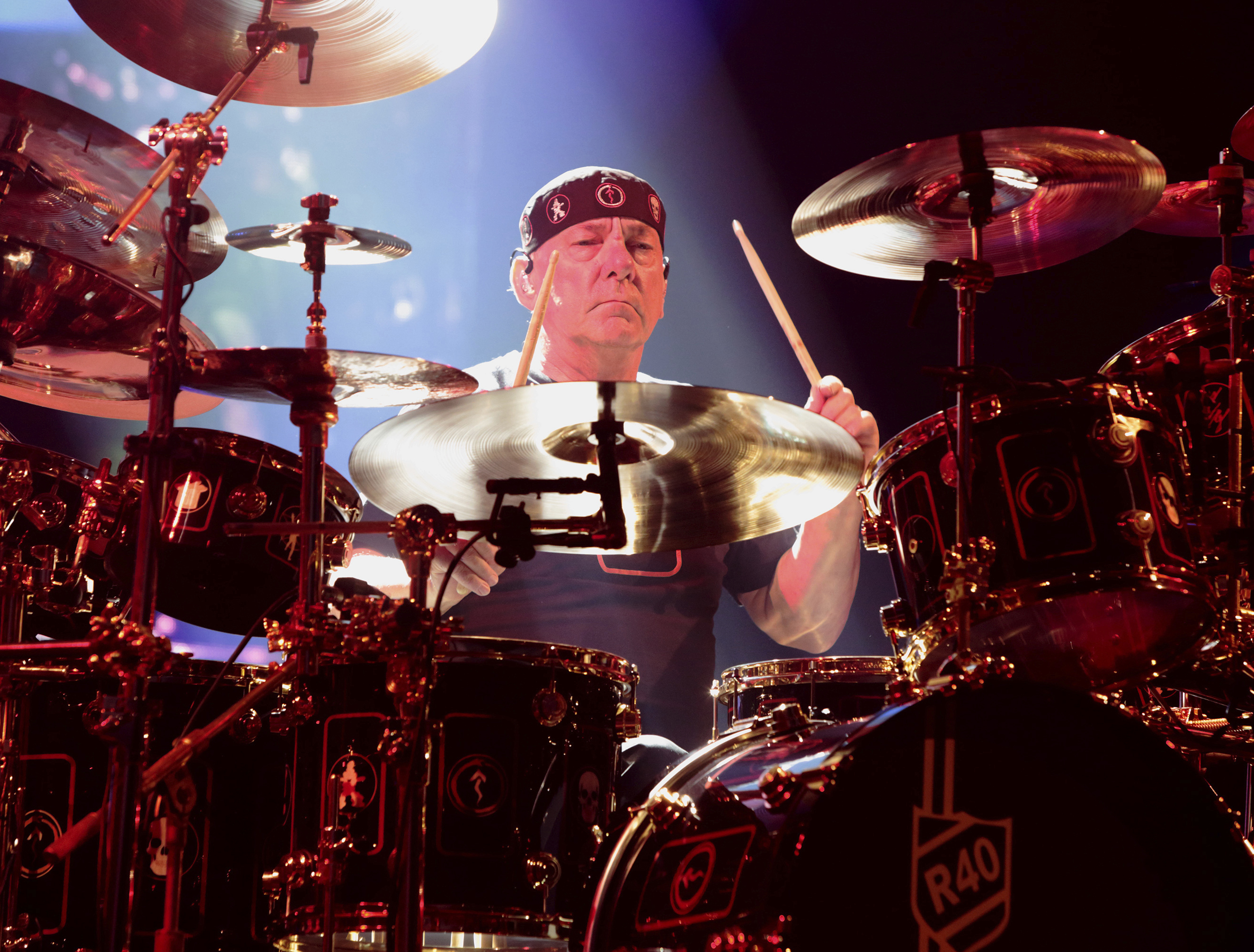 This 2015 file photo shows Neil Peart of the band Rush performing in concert during their R40 Live: 40th Anniversary Tour in Philadelphia.