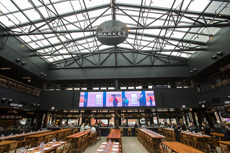 Time Out Market's space features a skylight, multiple stalls, and a large bar.