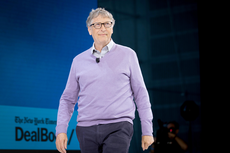 Bill Gates walks across a stage.