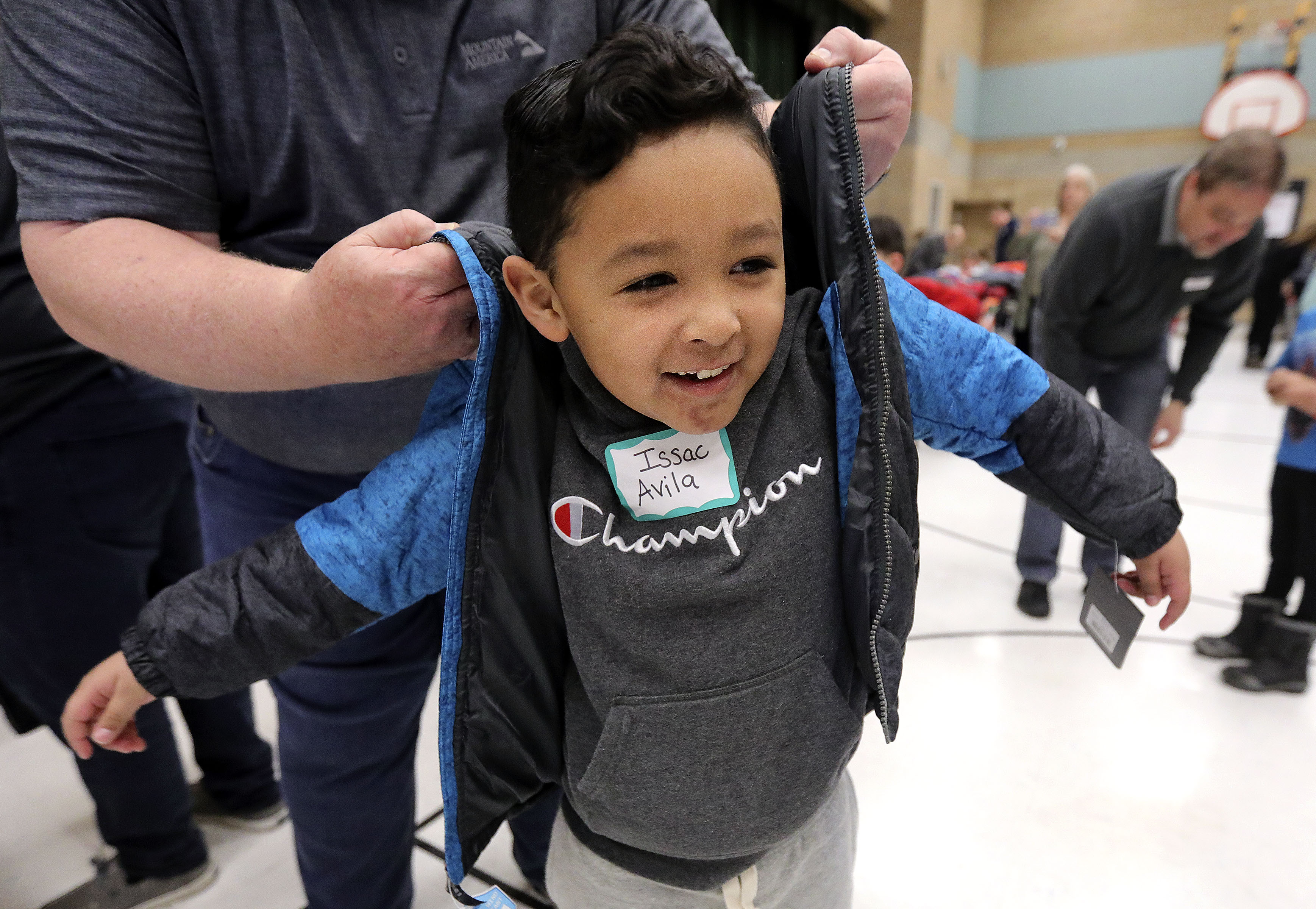 Issac Avila tries on a coat, donated by Mountain America Credit Union and Operation Warm, at Newman Elementary School in Salt Lake City on Friday, Jan. 10, 2020.