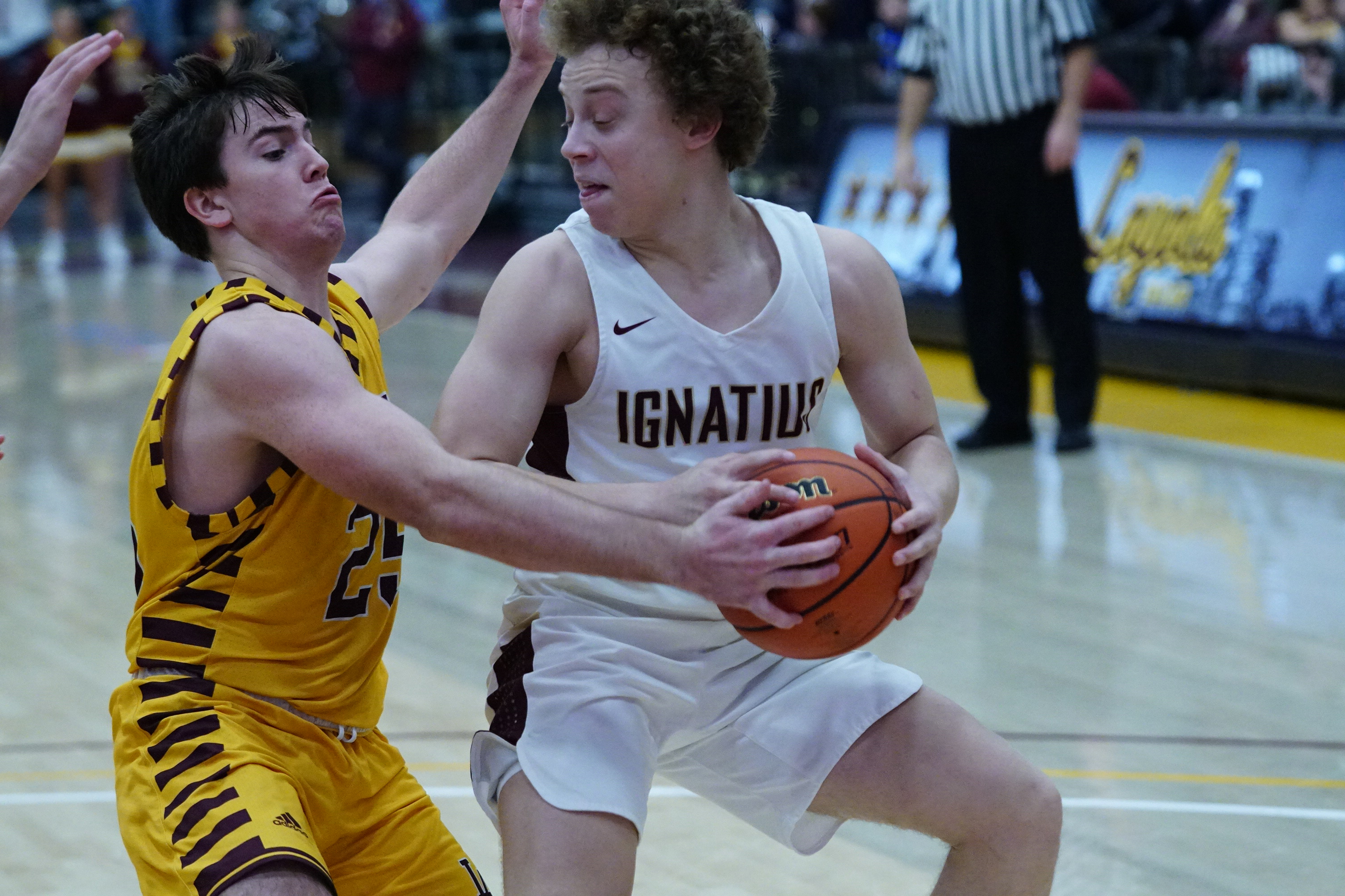 Loyola's Billy Palmer (25) swipes the ball away from Parker Higginbottom of St. Ignatius.