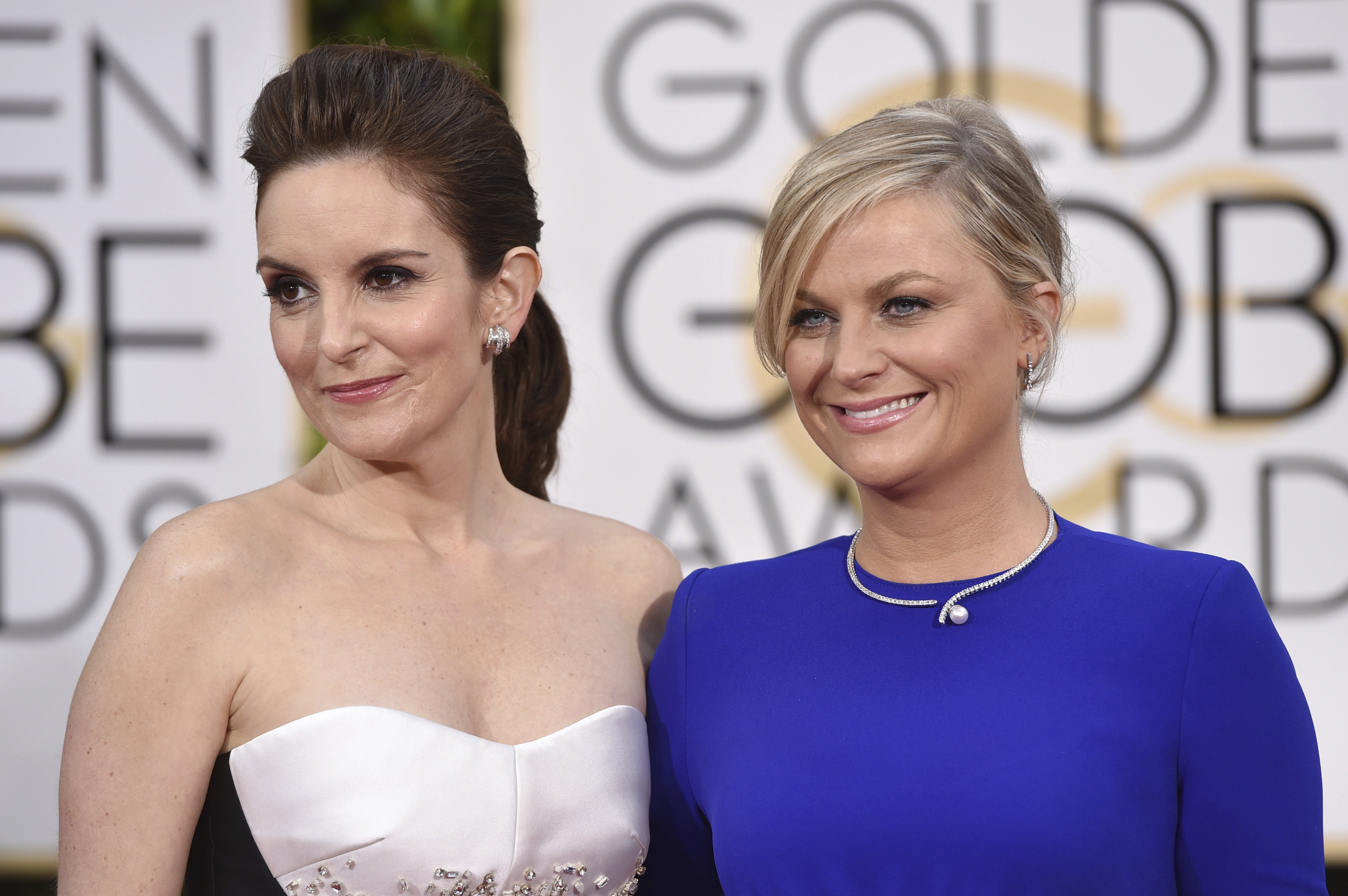 Tina Fey (left) and Amy Poehler arrive for the 72nd annual Golden Globe Awards in Beverly Hills in 2015.