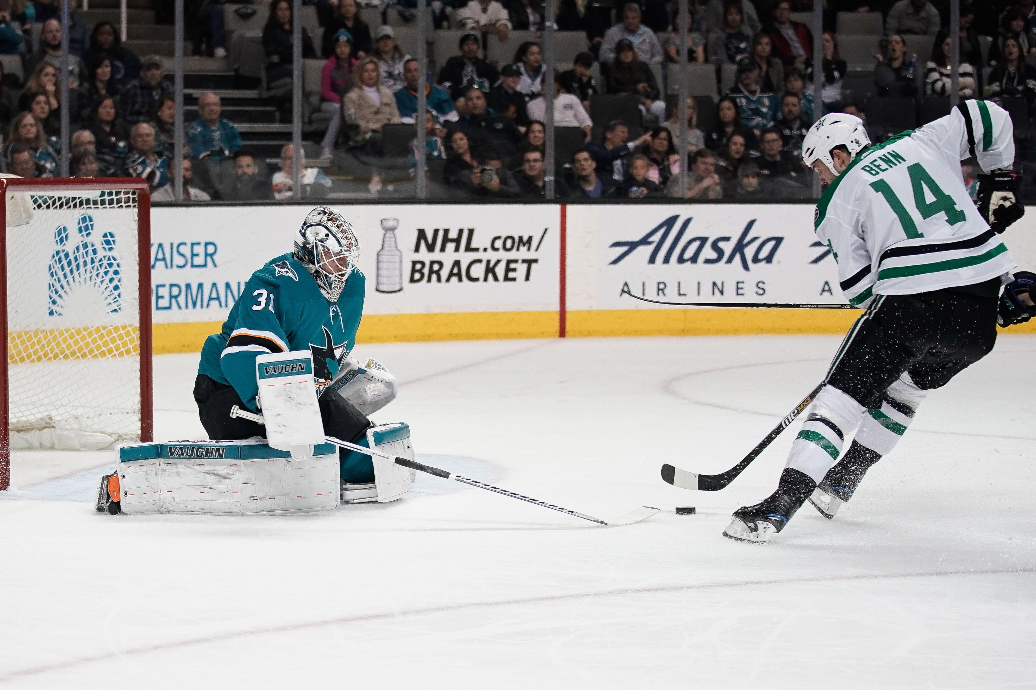 Apr 3, 2018; San Jose, CA, USA; San Jose Sharks goaltender Martin Jones (31) attempts to defend against Dallas Stars left wing Jamie Benn (14) during the third period at SAP Center at San Jose.