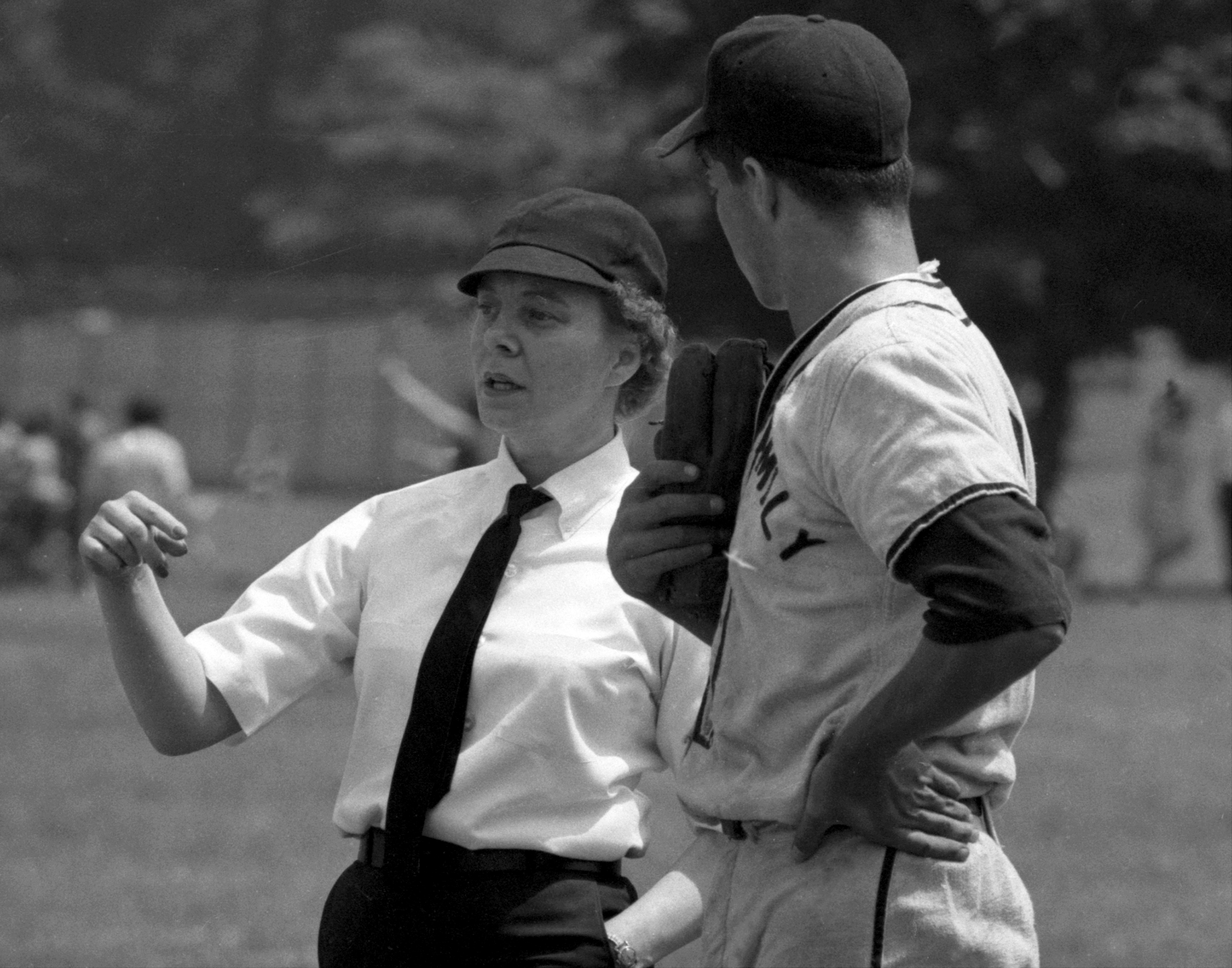 Woman umpire Bernice Gera at Holy Family baseball game at Cu