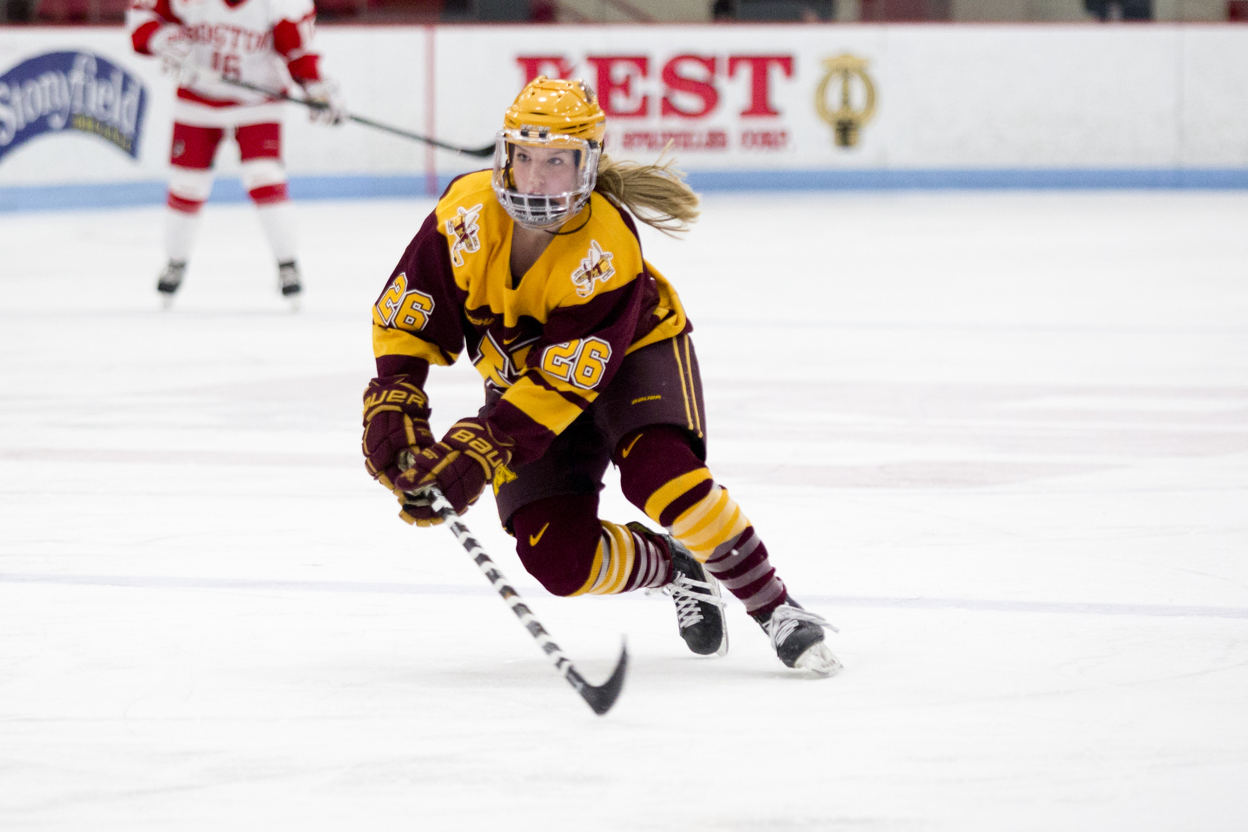 Sarah Potomak of the Minnesota Golden Gophers skates up the ice with the puck.