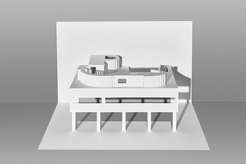 Paper cut out model of a multi-level building.