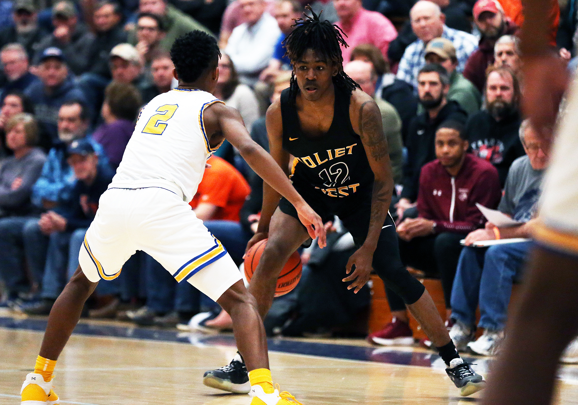 Joliet West's Jamere Hill (12) looks to beat Simeon's Jalen Hill off the dribble.