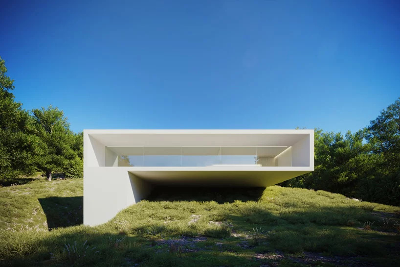 Rectilinear white house on a hill.