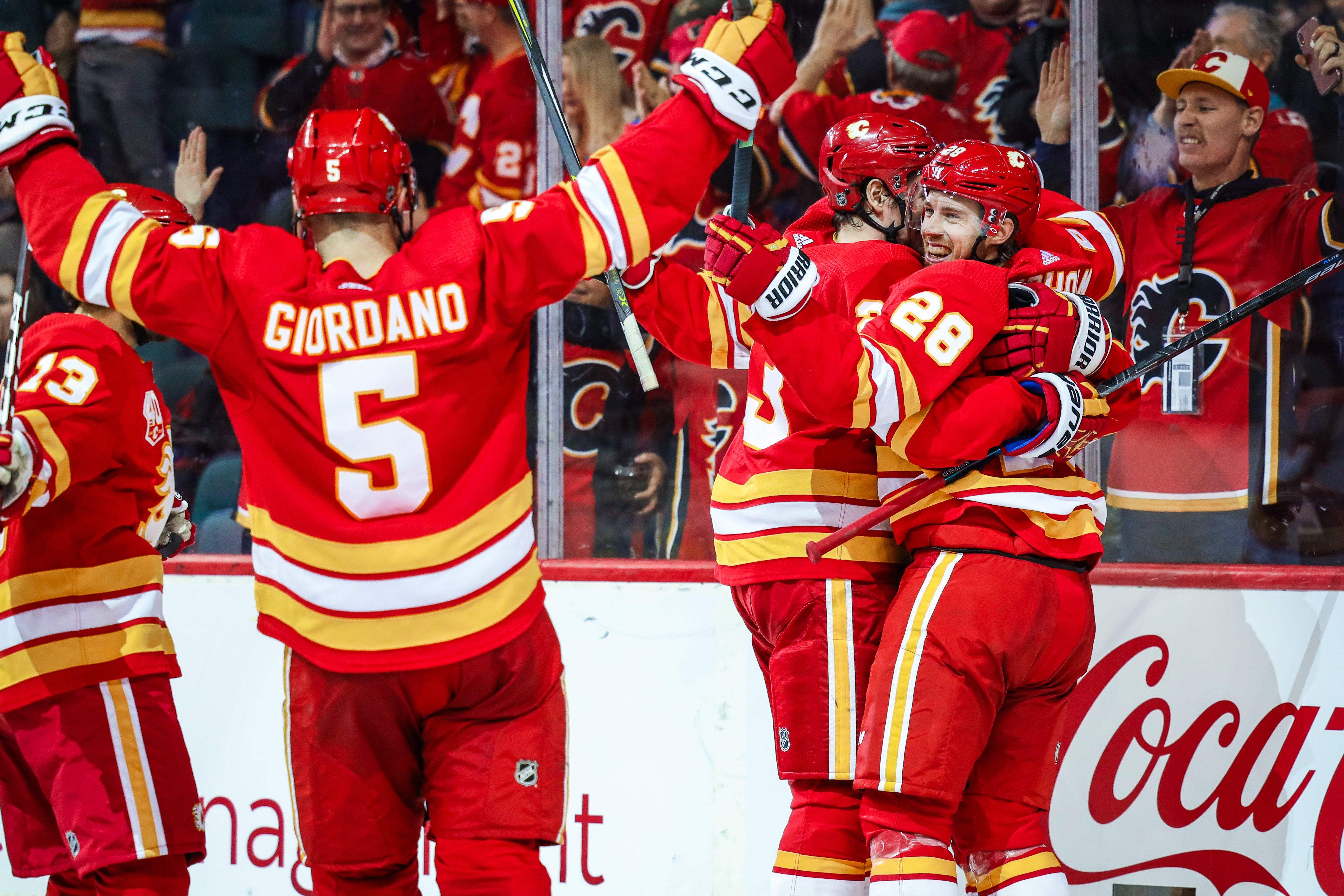 Jan 11, 2020; Calgary, Alberta, CAN; Calgary Flames center Elias Lindholm (28) celebrates his goal with teammates against the Edmonton Oilers during the third period at Scotiabank Saddledome. Calgary Flames won 4-3