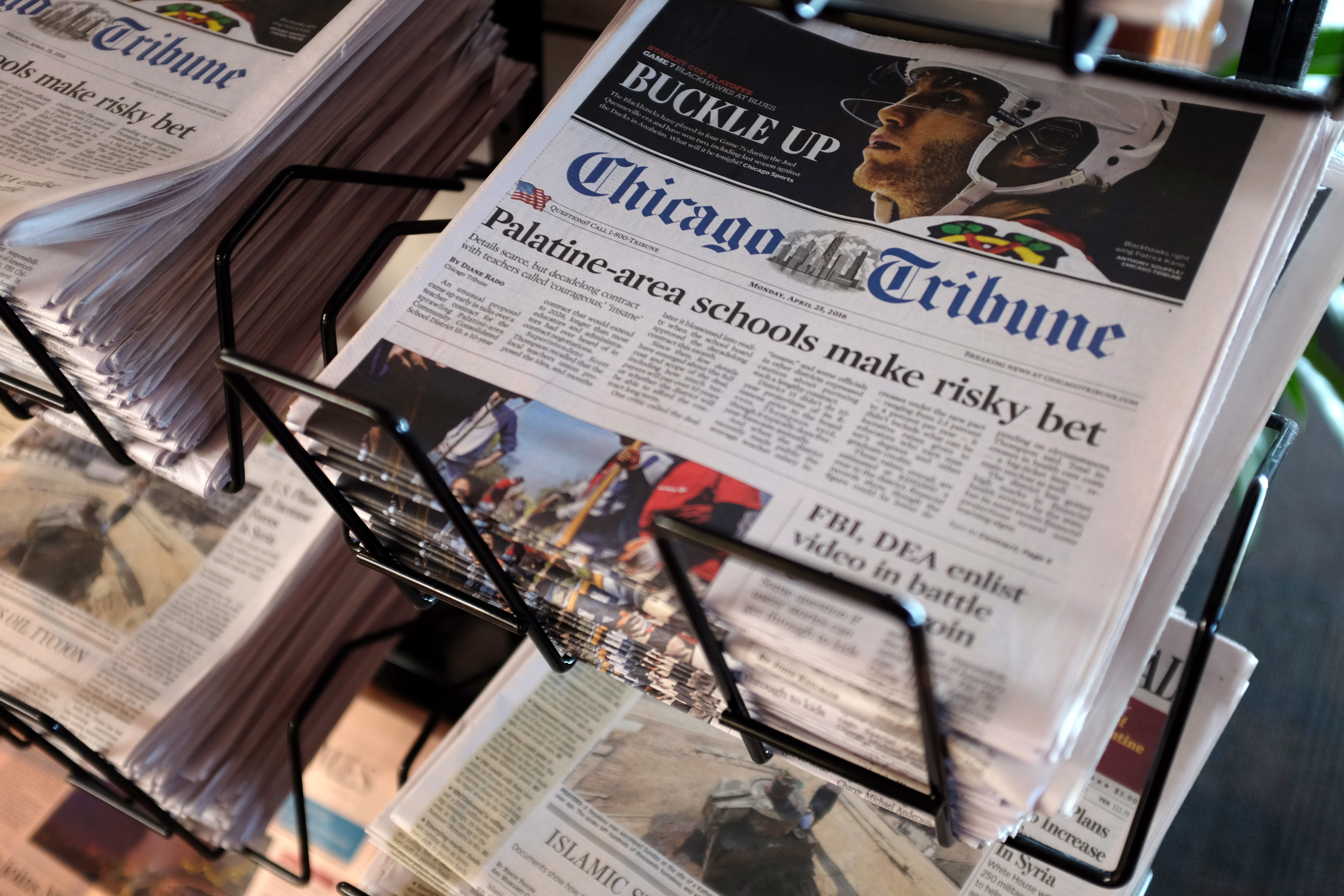 Chicago Tribune and other newspapers are displayed at Chicago's O'Hare International Airport,