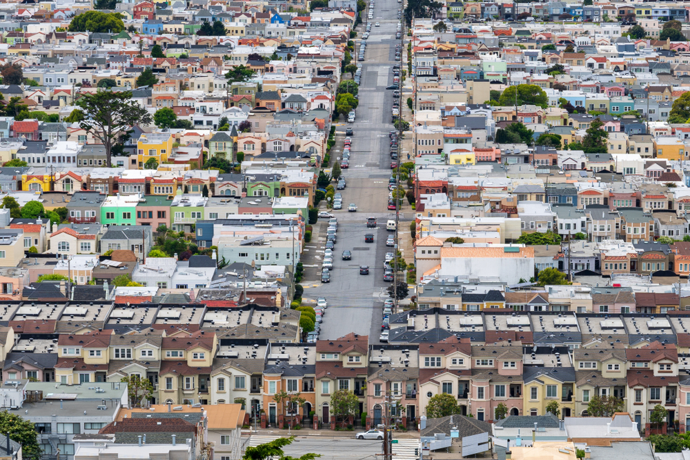 Rows of colorful San Francisco houses, seen from above.