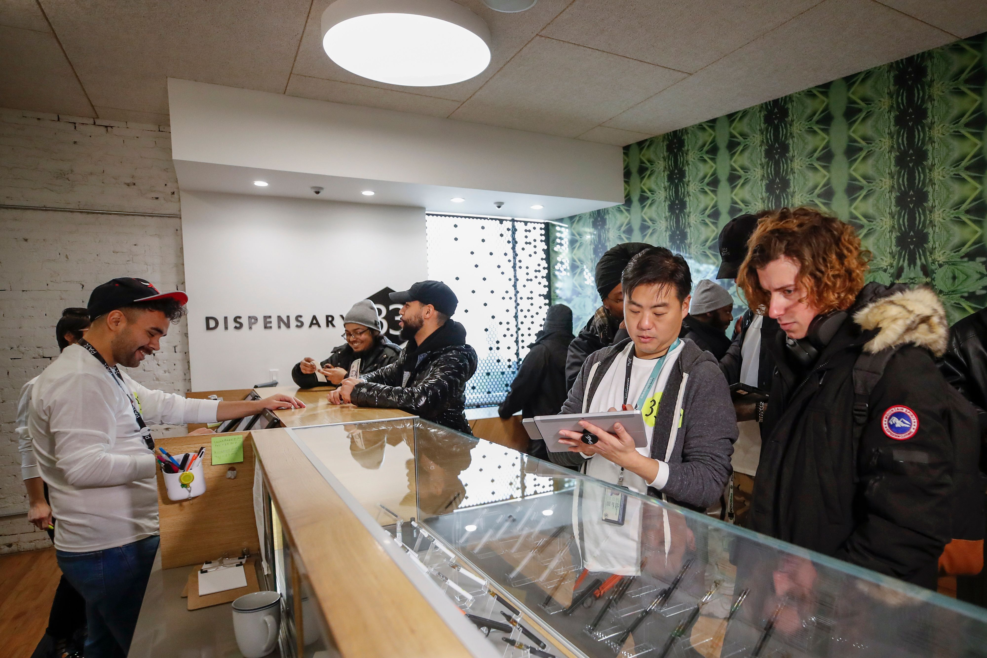 Customers shop for a recreational marijuana at Dispensary 33 store on January 1, 2020 in Chicago, Illinois.