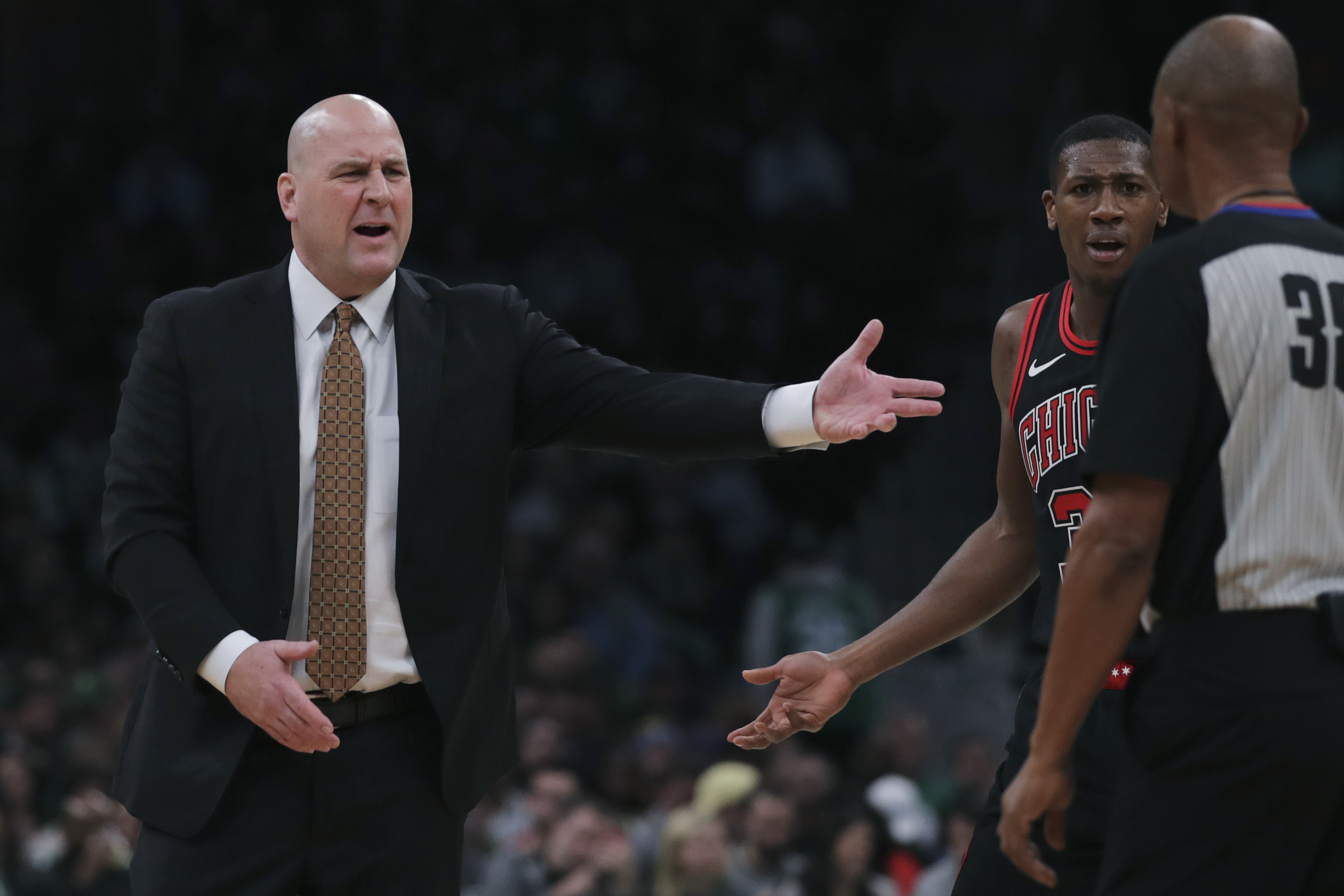 Bulls coach Jim Boylen argues a call during the first half of Monday's loss to the Celtics in Boston.