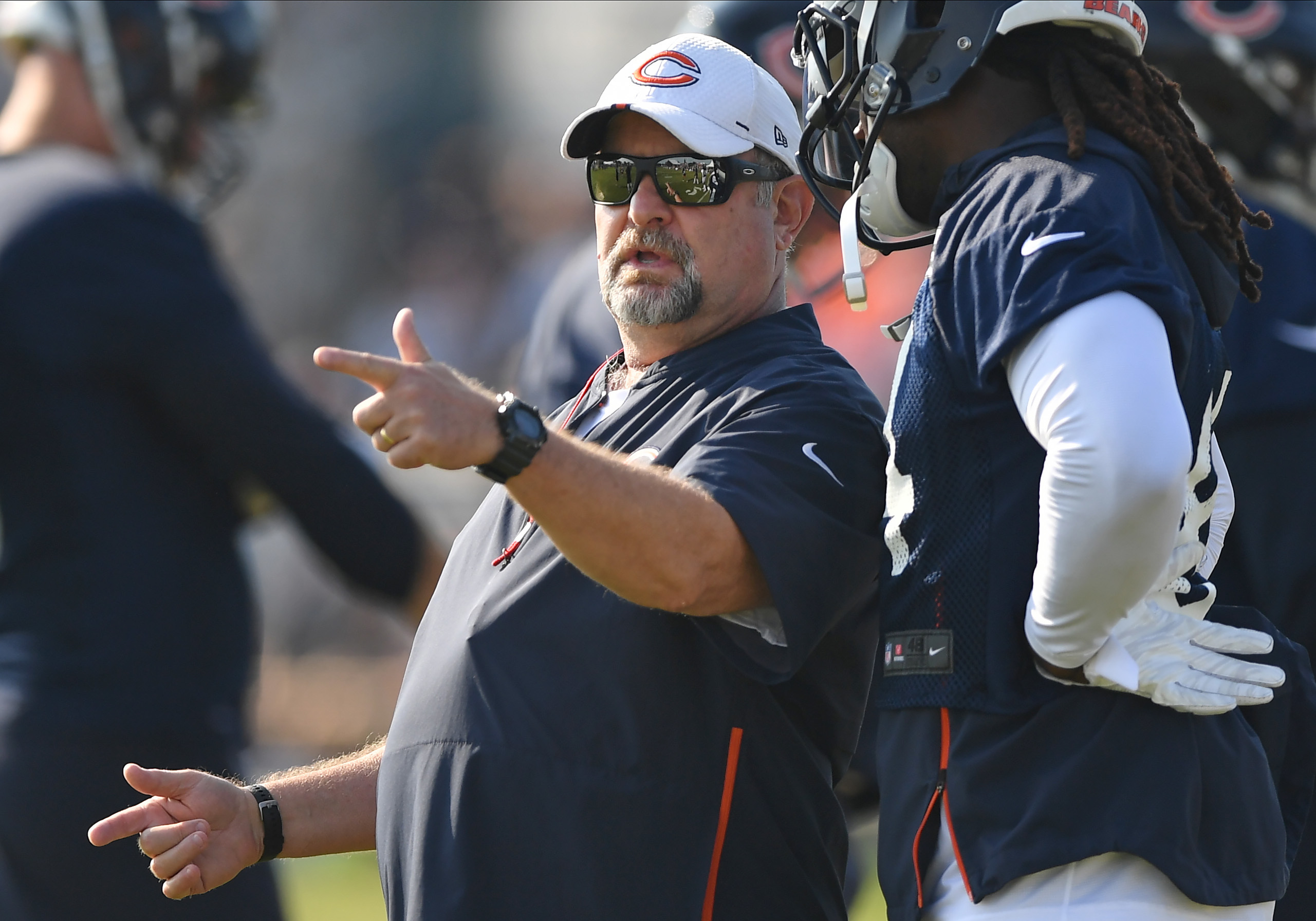 Bears coach Brad Childress gives instructions during training camp last year.