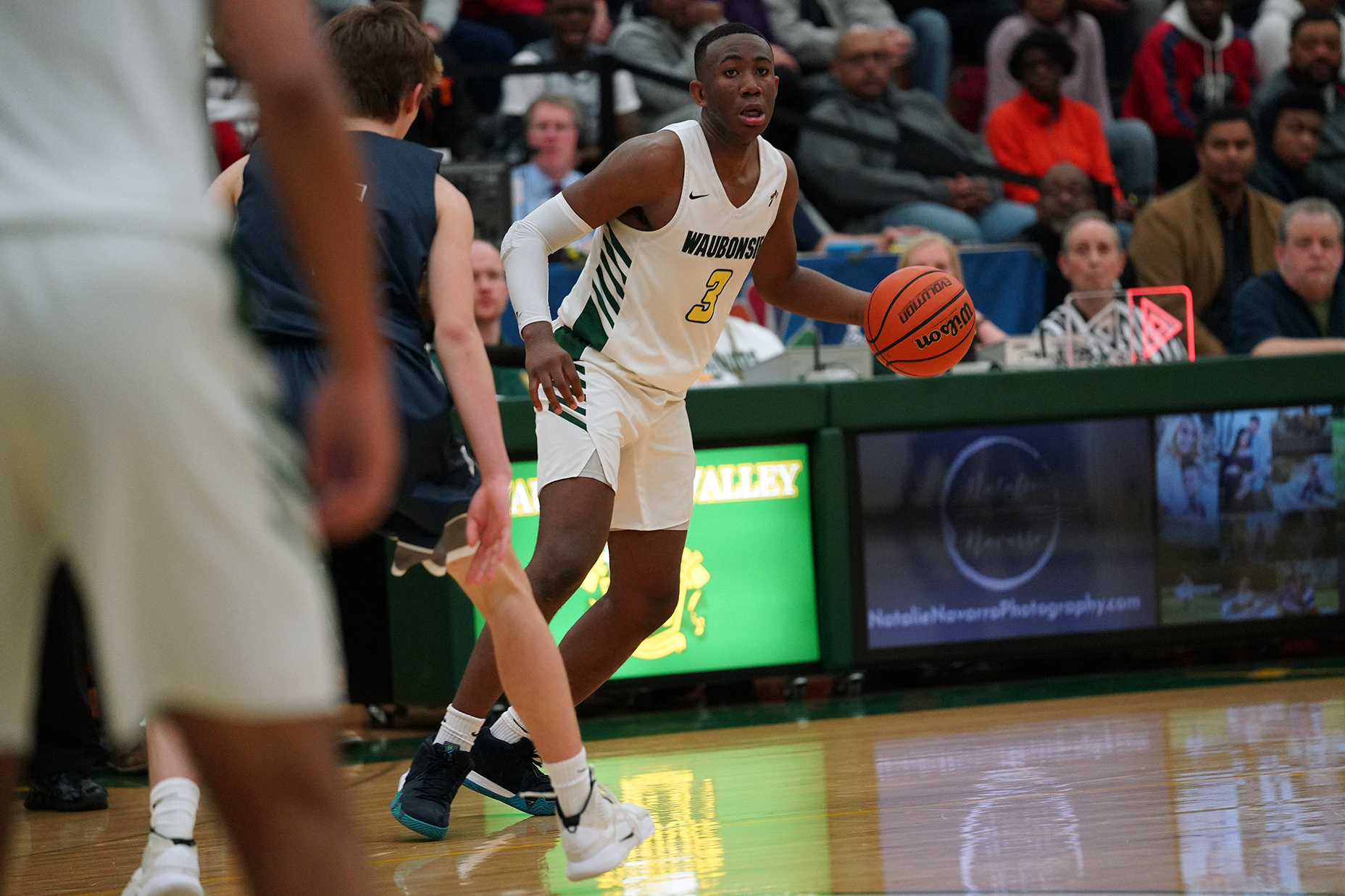 Waubonsie Valley's Marcus Skeete brings the ball back to the top of the key.