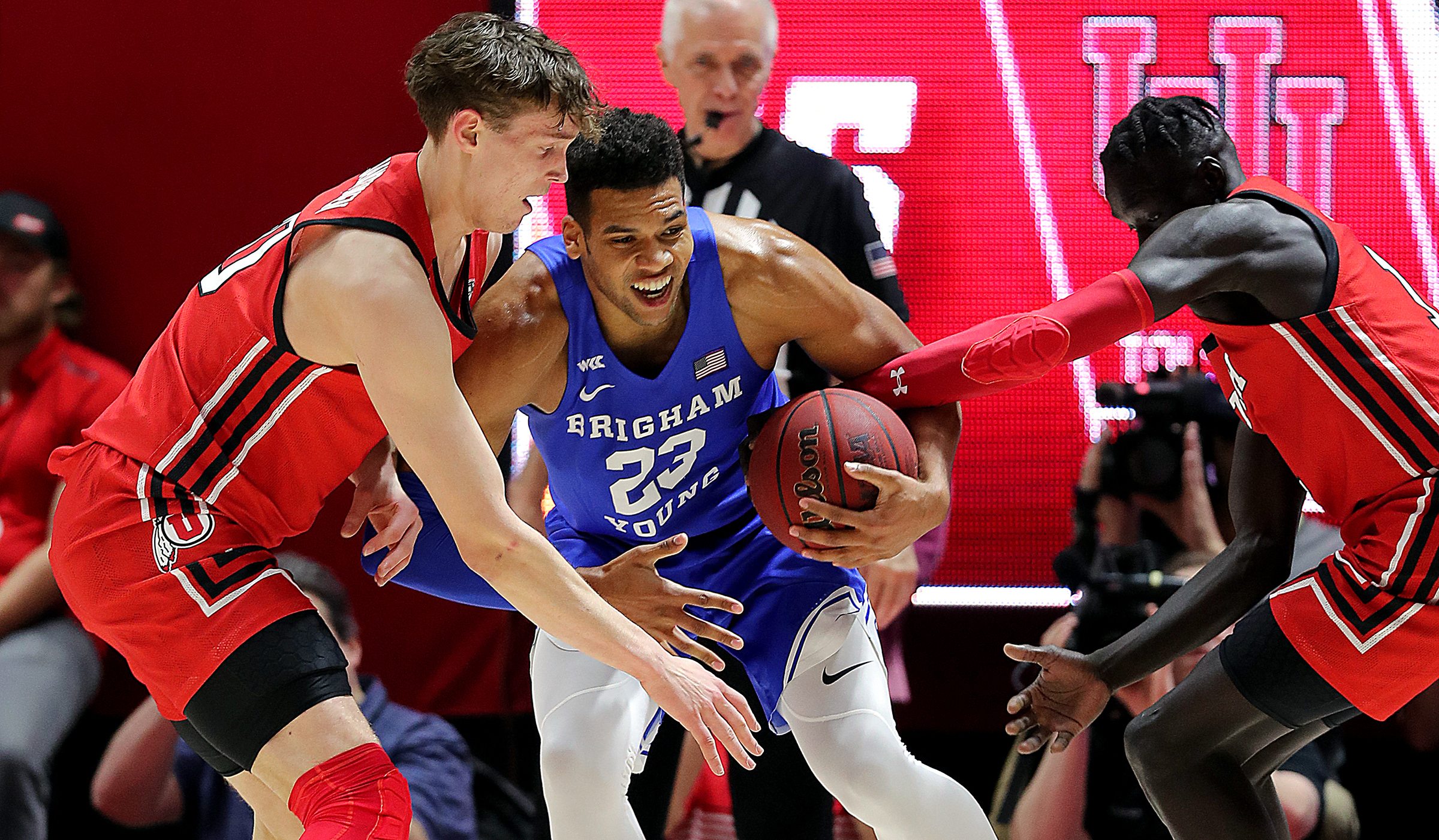Brigham Young Cougars forward Yoeli Childs (23) battles Utah Utes forward Mikael Jantunen (20) and Utah Utes guard Both Gach (11) as Utah and BYU play an NCAA basketball game at the Huntsman Center in Salt Lake City on Wednesday, Dec. 4, 2019.