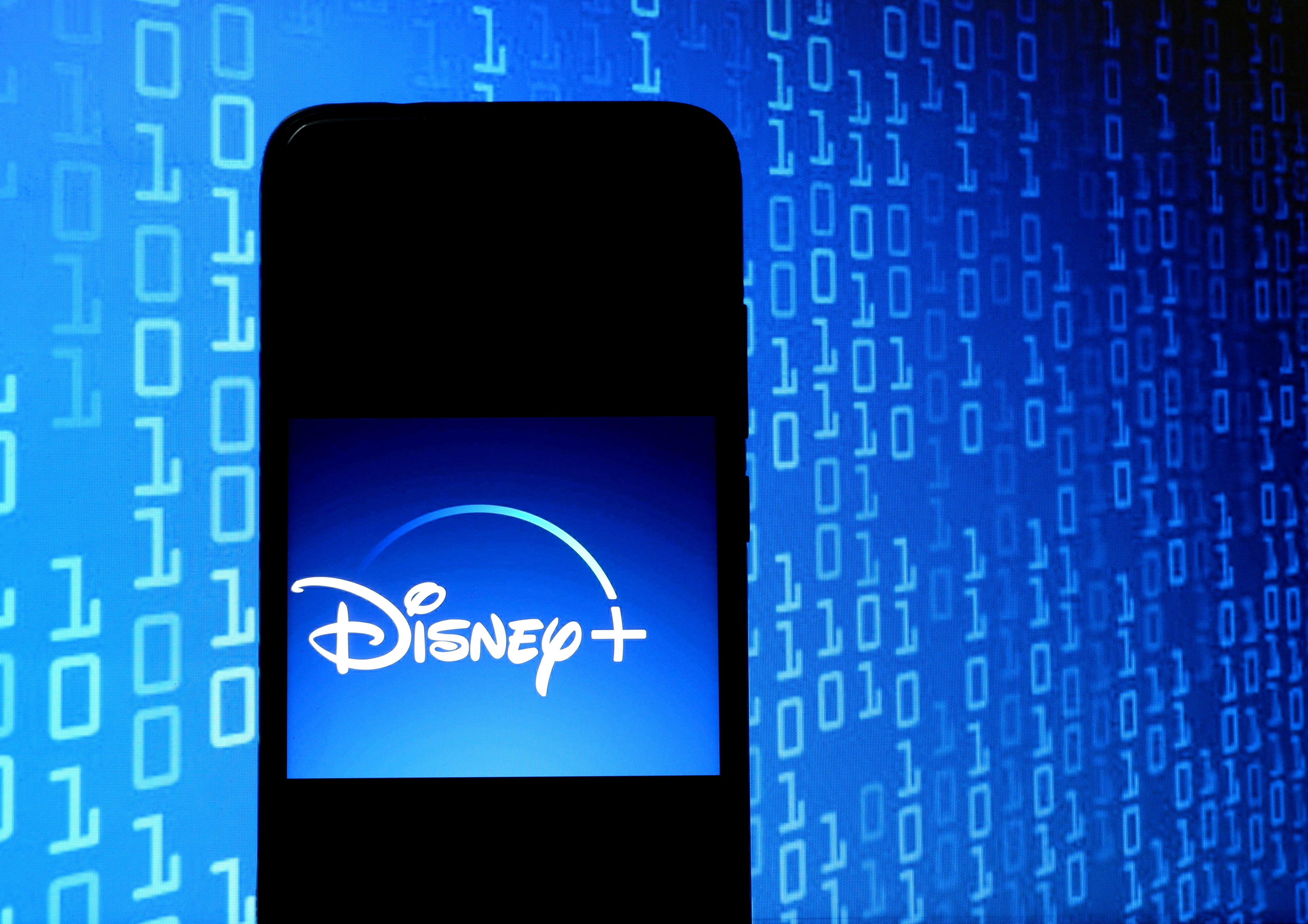 A photo illustration of the Disney+ app on a cellphone screen.