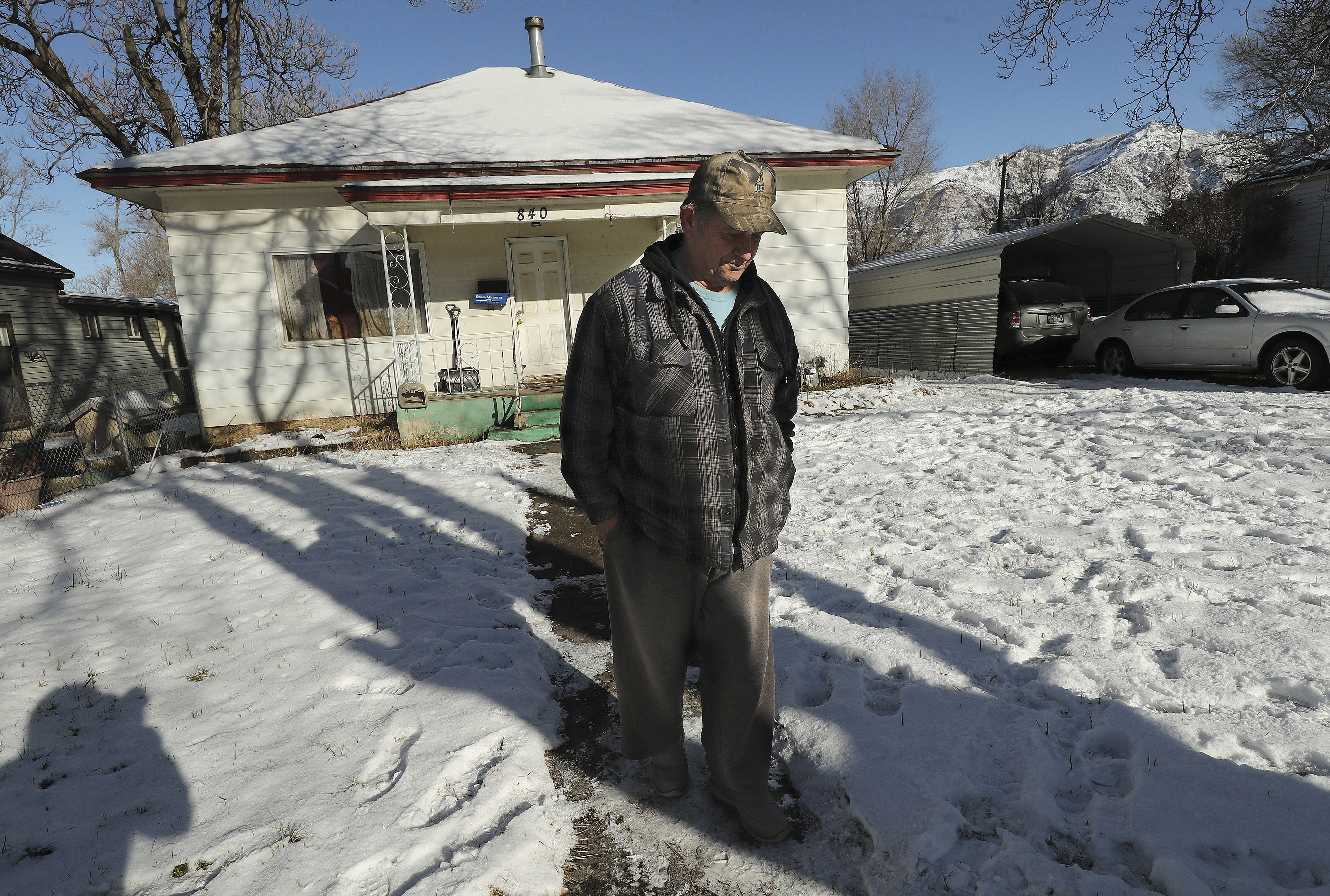 Dave Stanger walks from a house he owns at at 840 22nd St. in Ogden where two people were found dead on Wednesday, Jan. 15, 2020. Police responded to a welfare check and found the bodies.
