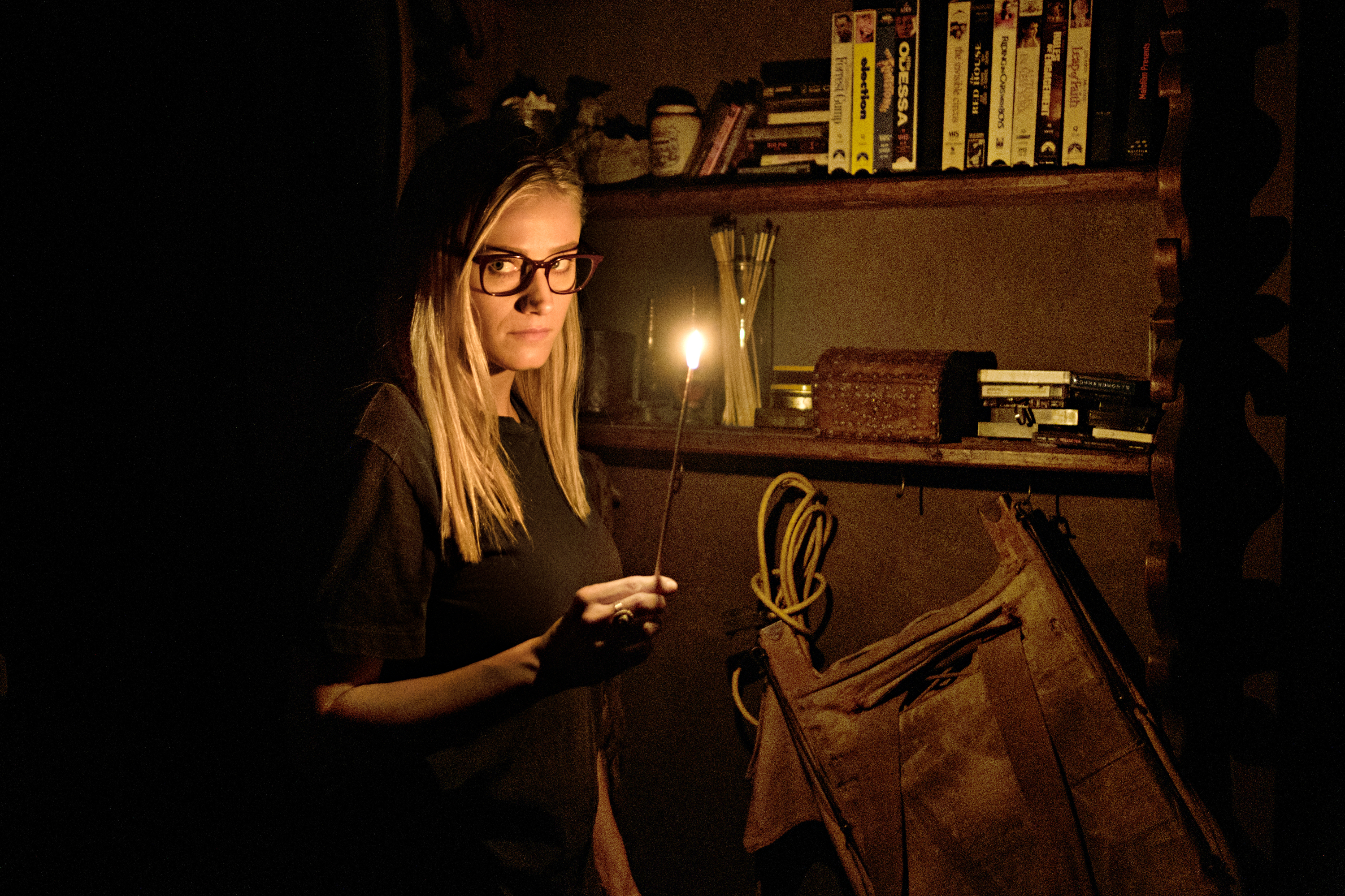 """Alice digs around in a murky old library on the Syfy show """"The Magicians."""""""