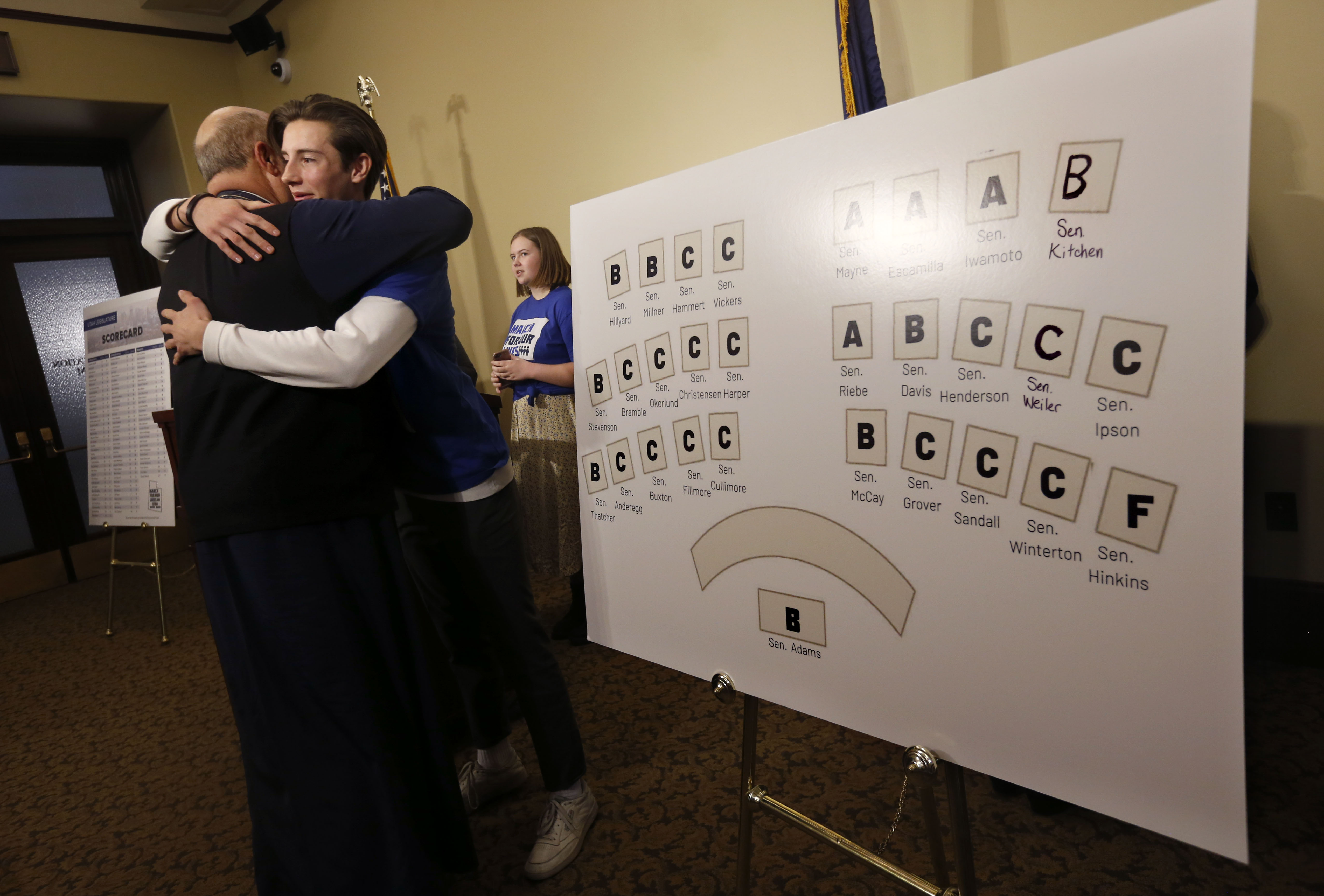 Father Elias Koucos, of St. Anna Greek Orthodox Church, hugs Andoni Telonidis, a member of March for Our Lives Utah and a senior at West High School, after a press conference at the Capitol in Salt Lake City on Wednesday, Jan. 15, 2020, where high school students voiced their concerns about gun violence and presented a report card for Utah legislators based on their voting records during the 2019 legislative session.