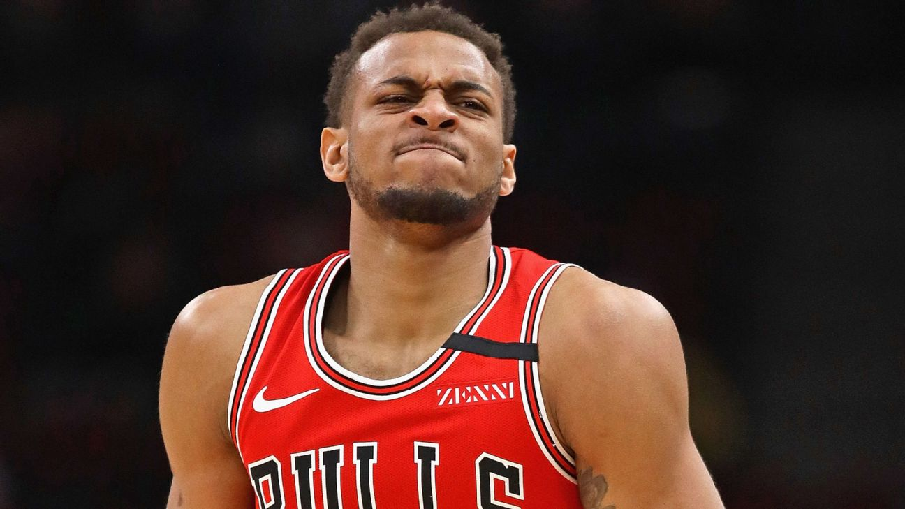 The Bulls' Daniel Gafford leaves the game after dislocating his right thumb Wednesday against the Washington Wizards at the United Center.
