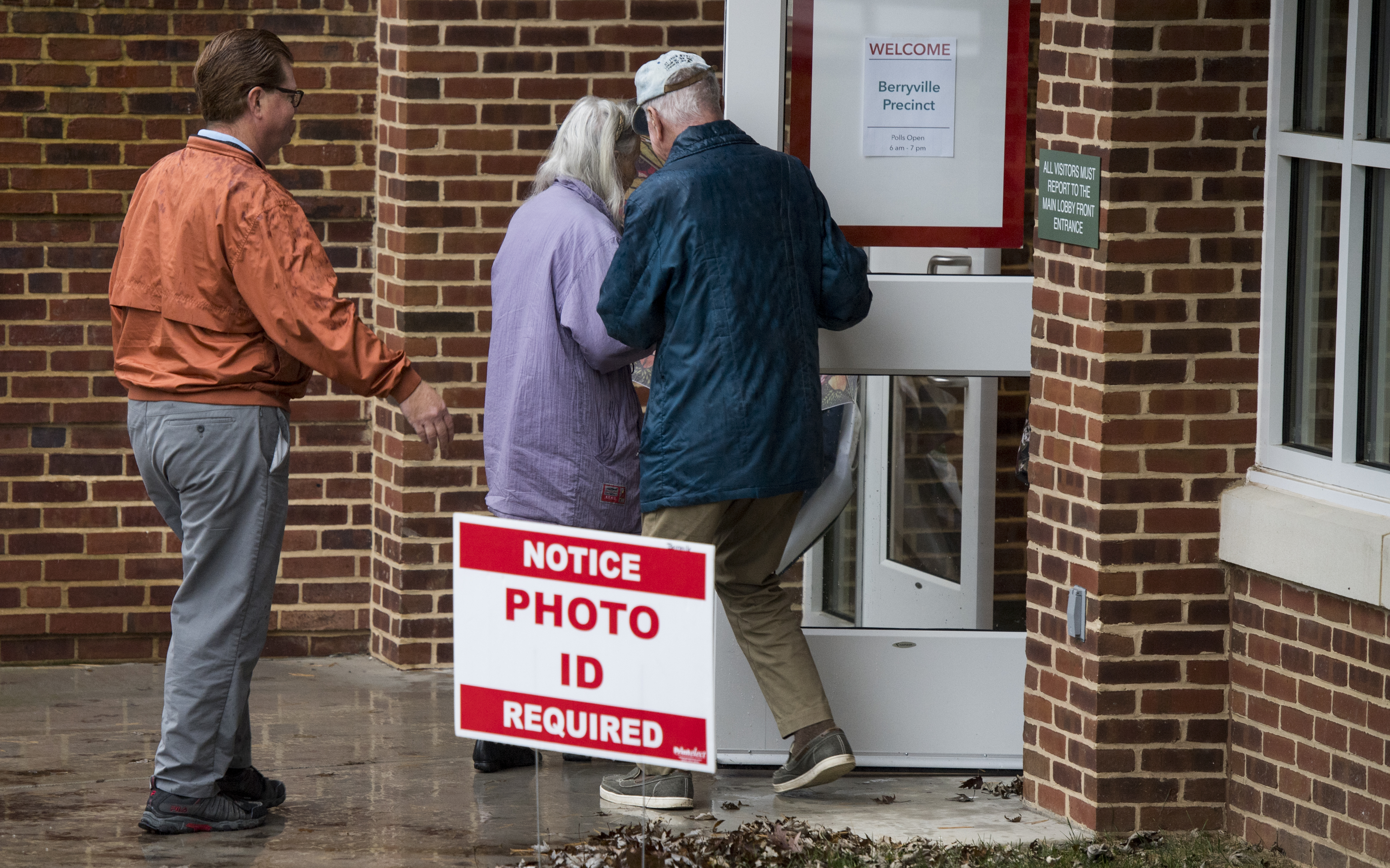 Sign saying Photo ID Required outside polling place.