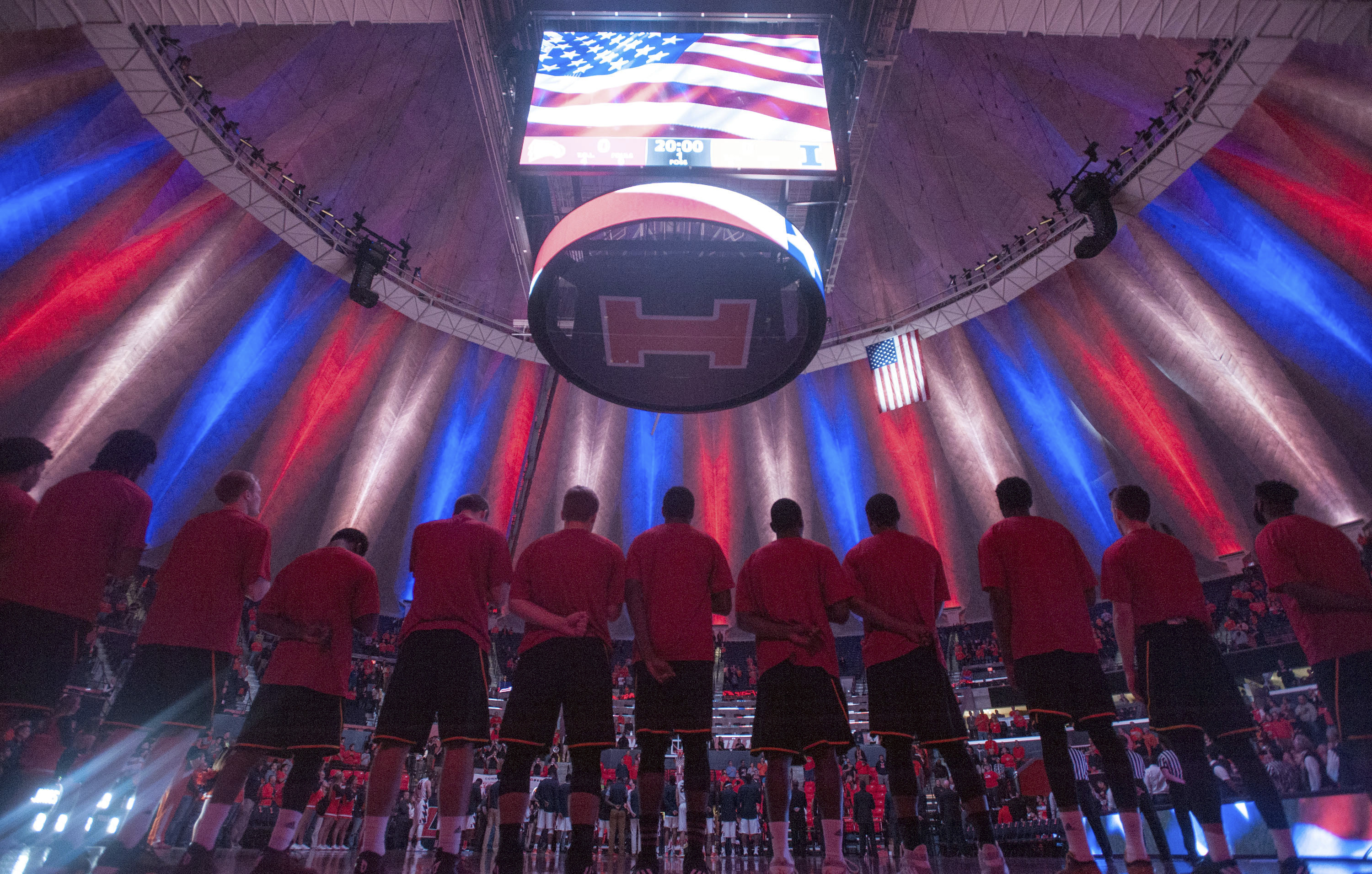 Winthrop players stand on the court during the national anthem before a game at the State Farm Center in Champaign-Urbana.