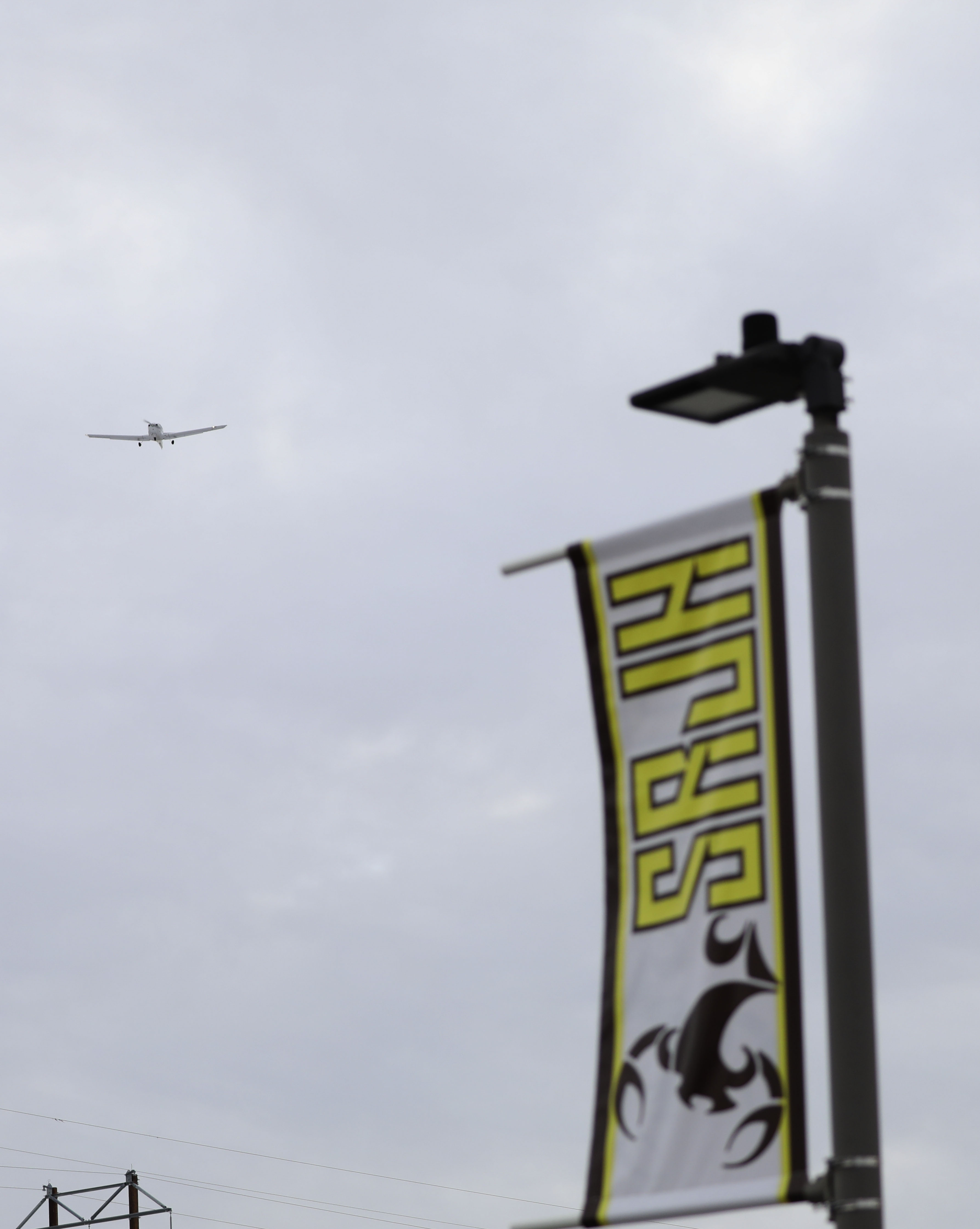 An aircraft flies in the vicinity of Sand Ridge Junior High School in Roy on Thursday, Jan. 16, 2020.