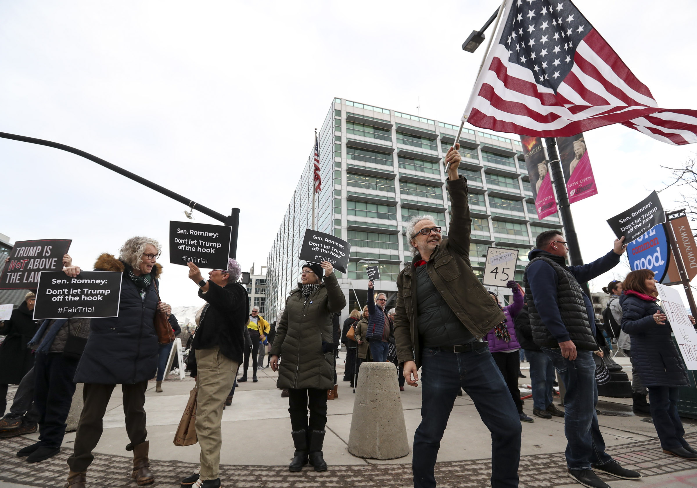 Samir Selmanozic , with Vote Common Good, waves an American flag as he and others rally at the Wallace G. Bennett Federal Building in Salt Lake City on Thursday, Jan. 16, 2020, for a full and fair impeachment trial of President Donald Trump.