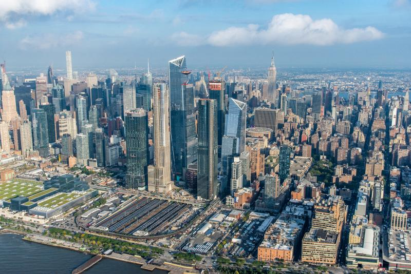 An aerial view of Hudson Yards and the many tall city buildings that surround it.